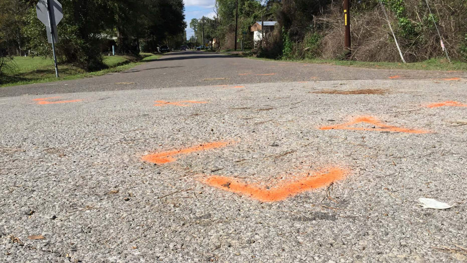 Nov. 4, 2015: This image shows orange paint marking the spot where a 6-year-old boy was shot and killed Tuesday night by Ward 2 city marshals in Marksville, La.