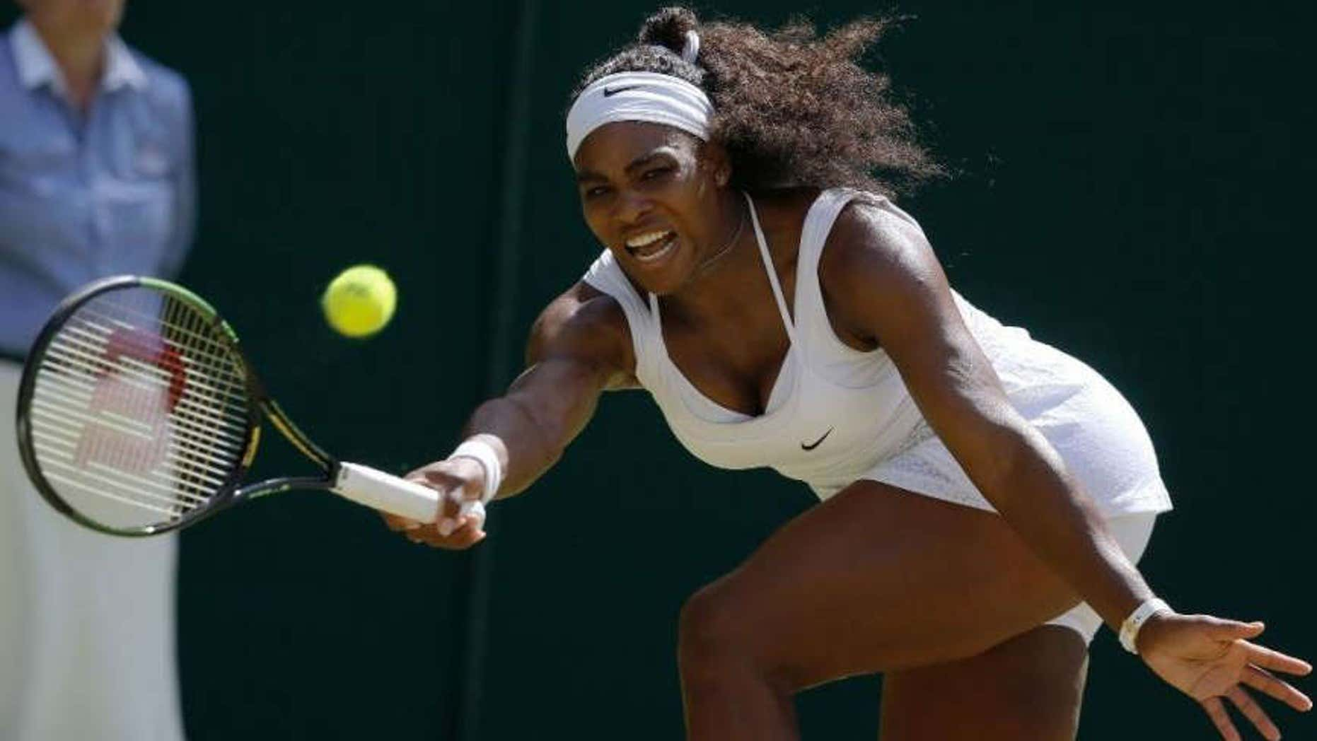 July 11, 2015: Serena Williams of the United States returns a shot to Garbine Muguruza of Spain, during the women's singles final at the All England Lawn Tennis Championships in Wimbledon, London.
