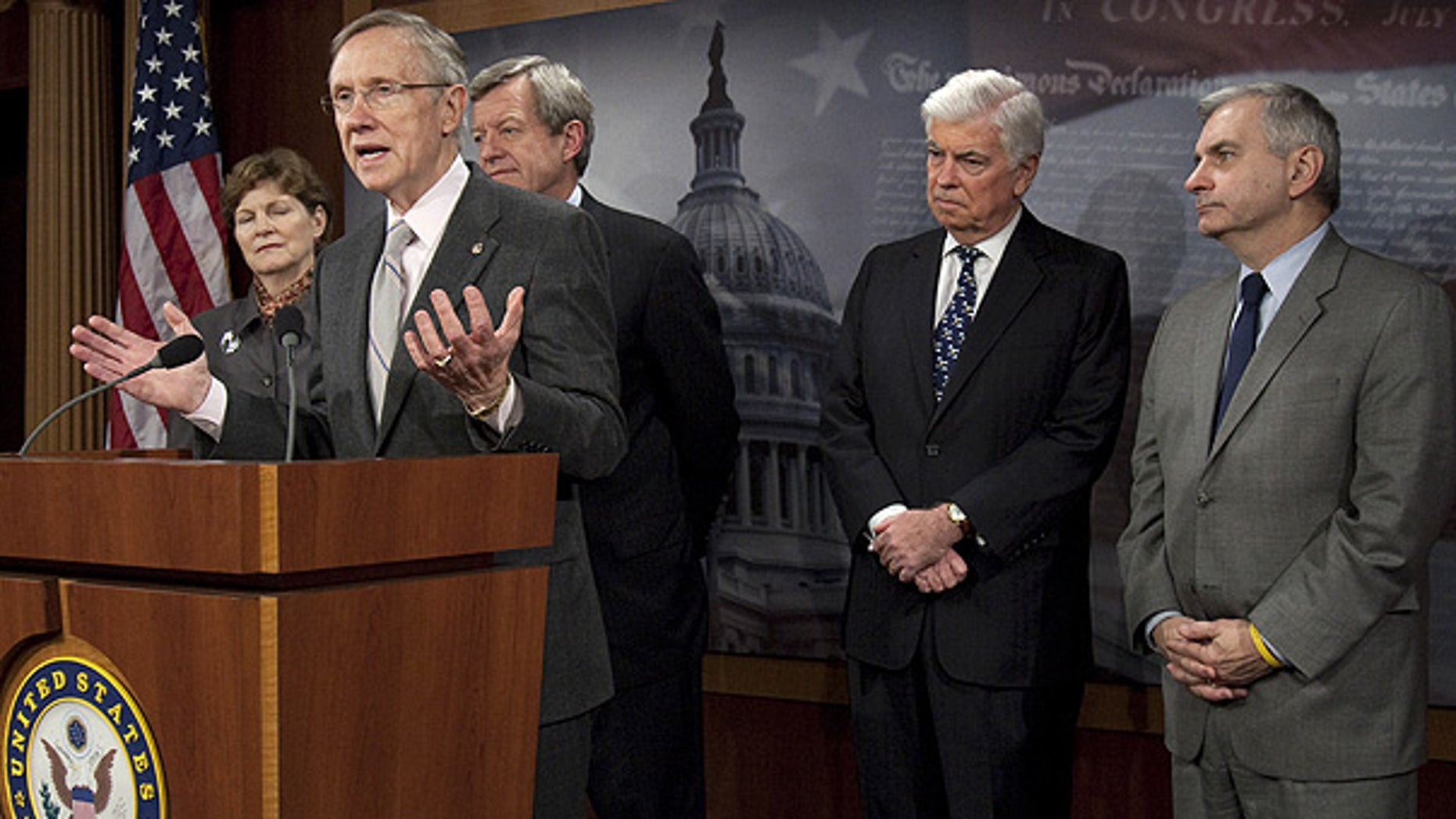 Nov. 4: Senate Majority Leader Harry Reid speaks as Sens. Jeanne Shaheen, Max Baucus, Chris Dodd, and Jack Reed listen on Capitol Hill. (AP)
