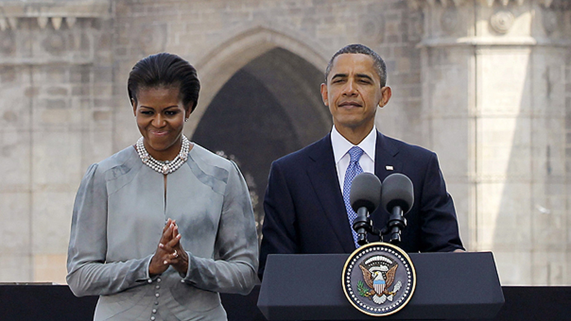 Nov. 6: President Obama and first lady Michelle Obama make a statement after their visit the memorial for the Nov. 26, 2008 terror attack victims at the Taj Mahal Palace and Tower Hotel in Mumbai, India.