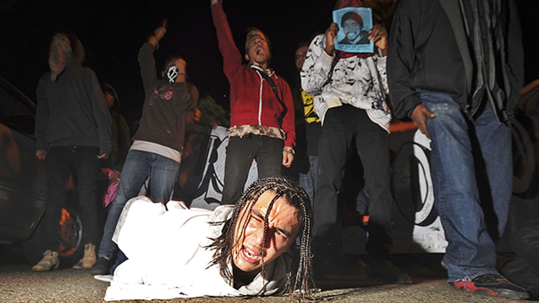 Nov. 5: A demonstrator lies on the ground during a protest after the sentencing of ormer Bay Area Rapid Transit police officer Johannes Mehserle.
