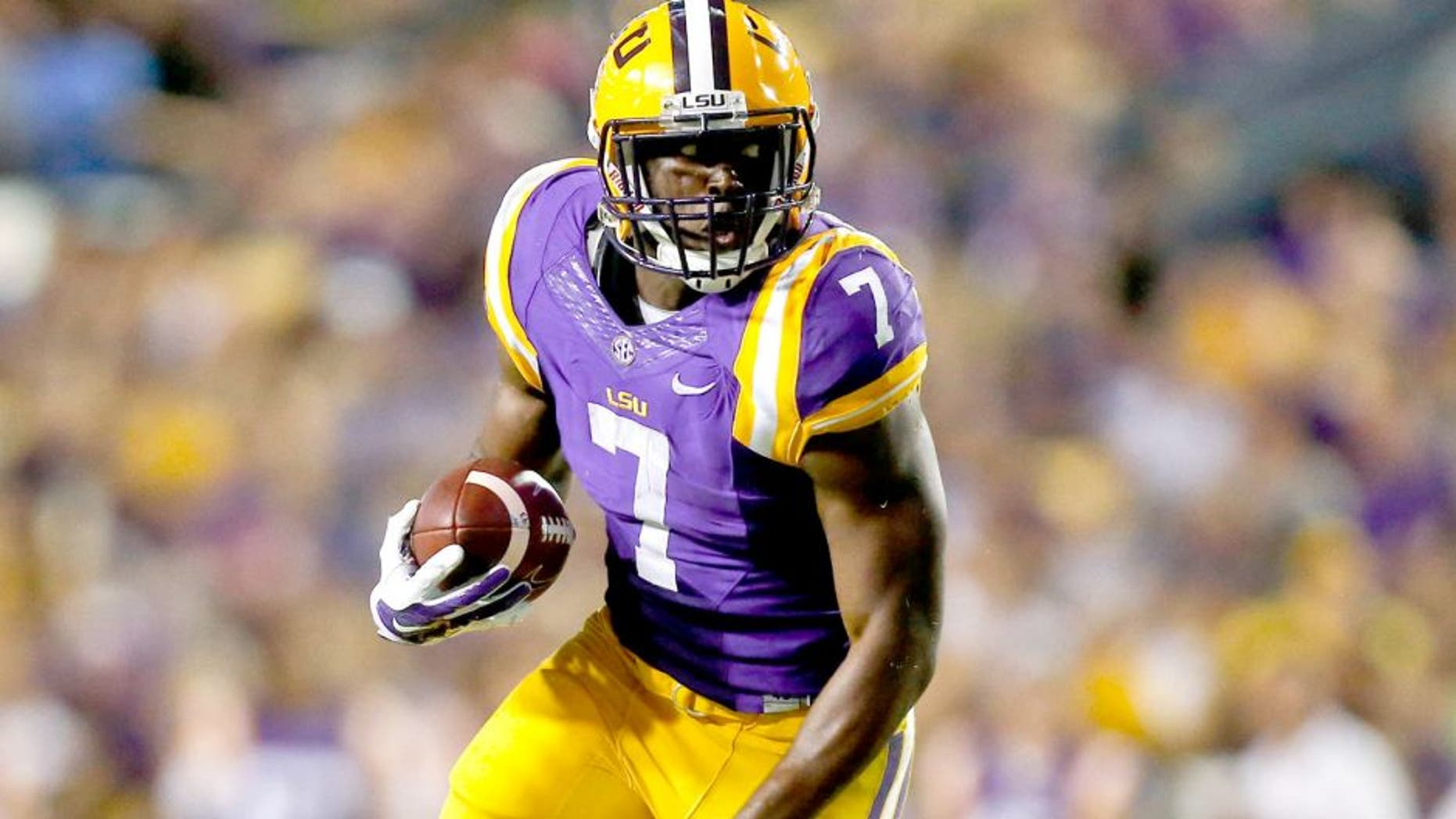 Sep 27, 2014; Baton Rouge, LA, USA; LSU Tigers running back Leonard Fournette (7) breaks loose for a touchdown run against the New Mexico State Aggies during the second quarter of a game at Tiger Stadium. Mandatory Credit: Derick E. Hingle-USA TODAY Sports