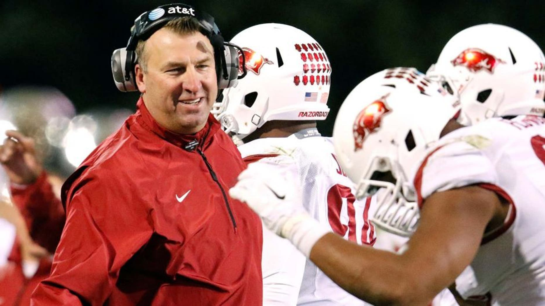 Nov 1, 2014; Starkville, MS, USA; Arkansas Razorbacks head coach Bret Bielema congratulates his players after a play during the game against the Mississippi State Bulldogs at Davis Wade Stadium. The Bulldogs defeat the Razorbacks 17-10. Mandatory Credit: Marvin Gentry-USA TODAY Sports