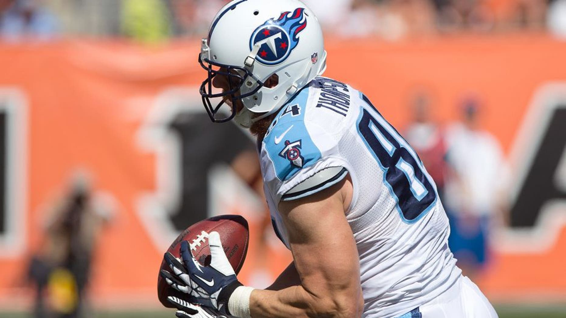 Sep 21, 2014; Cincinnati, OH, USA; Tennessee Titans tight end Taylor Thompson (84) is unable to make a catch against the Cincinnati Bengals at Paul Brown Stadium. The Bengals won 33-7. Mandatory Credit: Aaron Doster-USA TODAY Sports