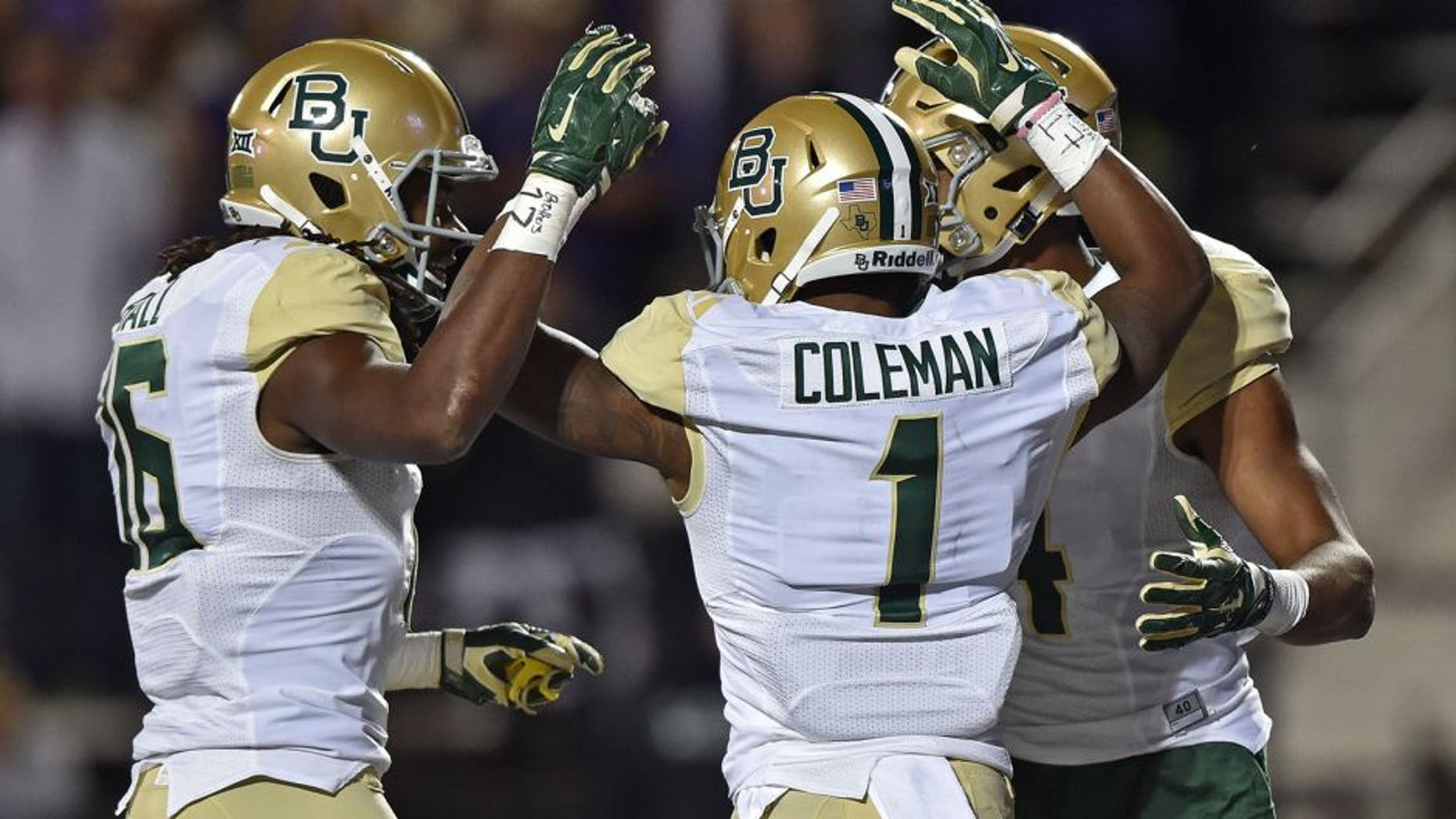 MANHATTAN, KS - NOVEMBER 05: Wide receiver Corey Coleman #1 of the Baylor Bears celebrates with teammates after scoring a touchdown against the Kansas State Wildcats during the first half on November 5, 2015 at Bill Snyder Family Stadium in Manhattan, Kansas. (Photo by Peter G. Aiken/Getty Images)