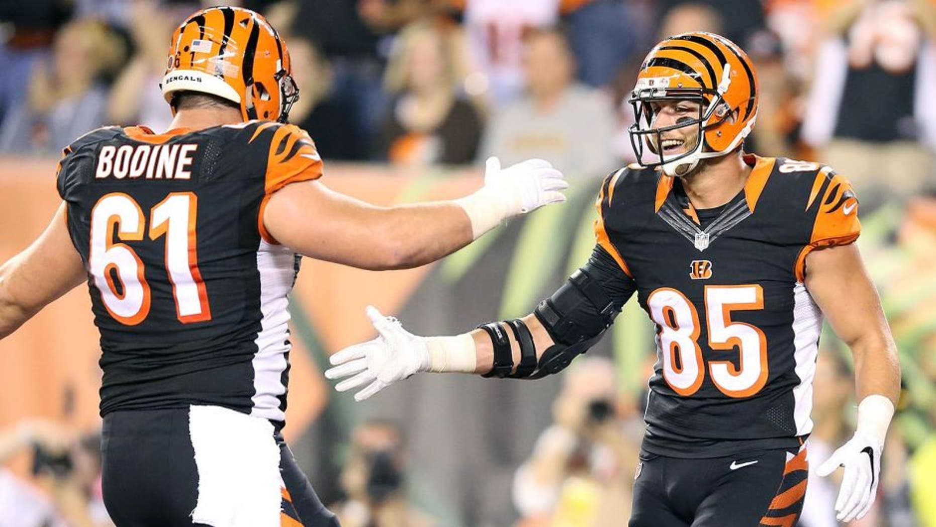 CINCINNATI, OH - NOVEMBER 5: Tyler Eifert #85 of the Cincinnati Bengals is congratulated by Russell Bodine #61 of the Cincinnati Bengals after scoring a touchdown during the second quarter of the game against the Cleveland Browns at Paul Brown Stadium on November 5, 2015 in Cincinnati, Ohio. (Photo by Andy Lyons/Getty Images)