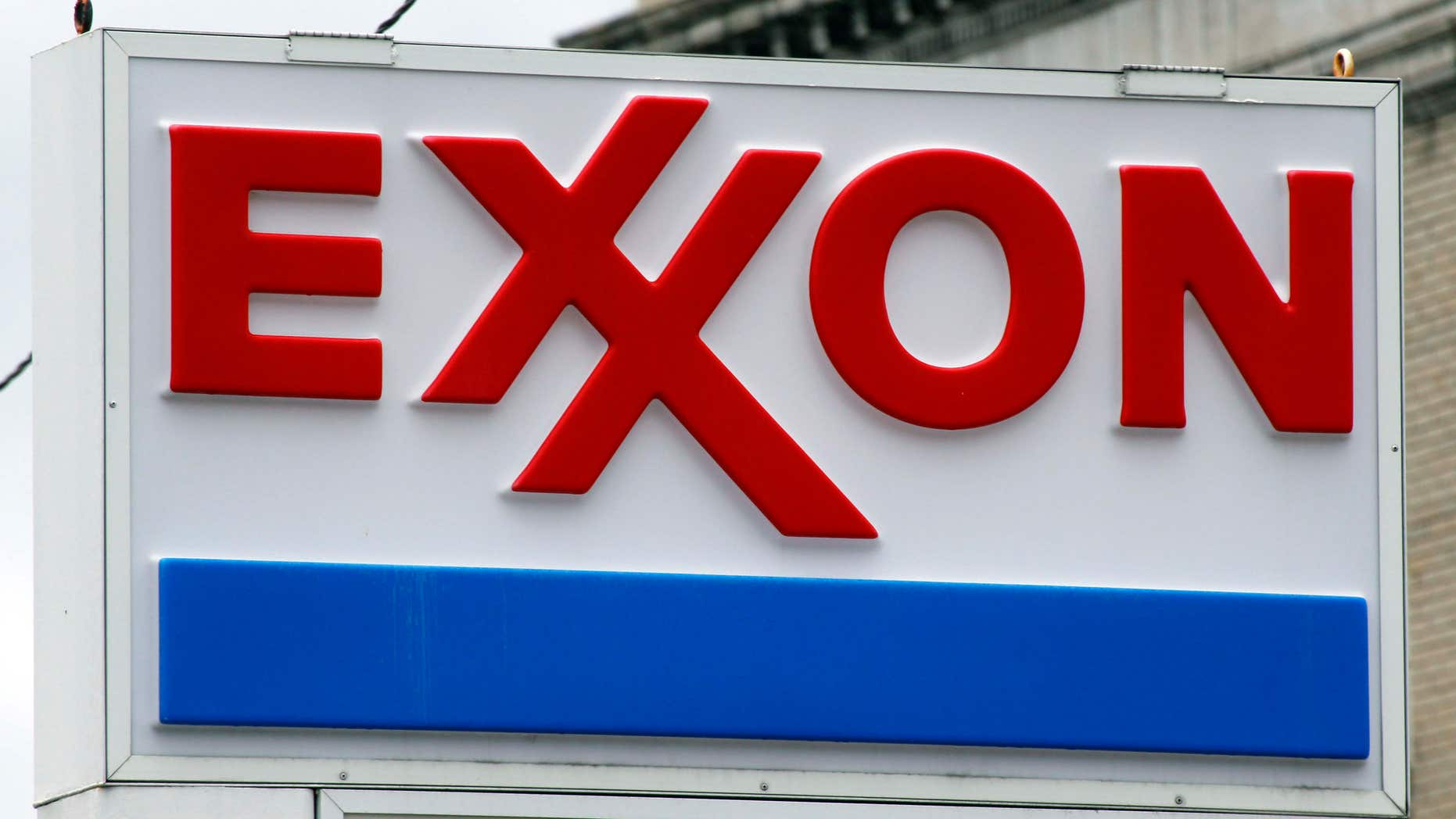 FILE - This April 29, 2014, file photo shows an Exxon sign at a mini-mart in Dormont, Pa.