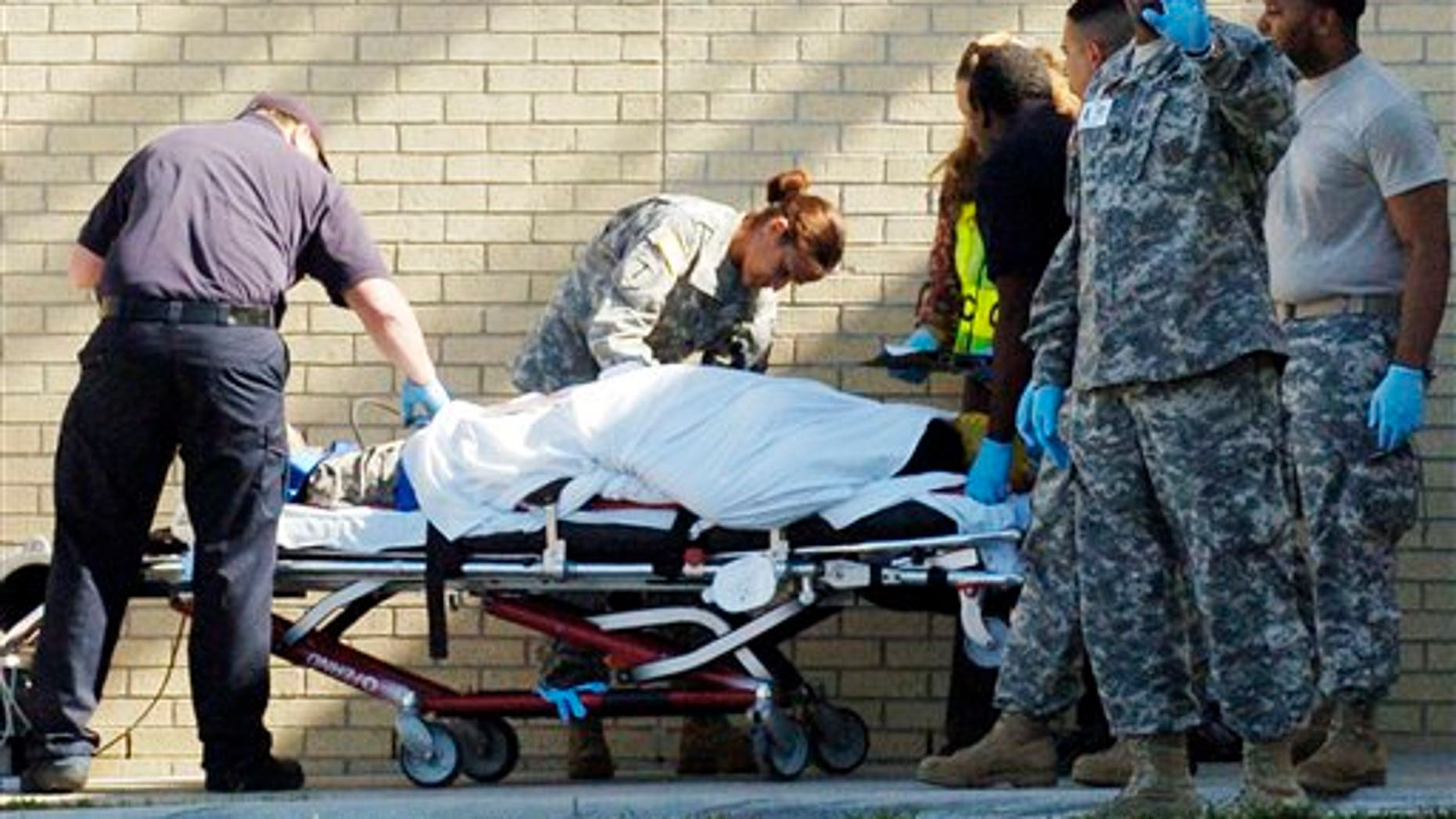 Nov. 5: Emergency personnel transport an unidentified soldier from the Soldier Readiness Center following a shooting at Fort Hood, Texas.