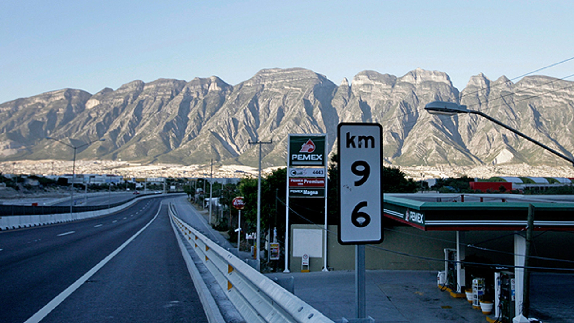 Nov. 5: A gas station is shown on the side of the highway from Saltillo to Monterrey, Mexico. With killings and disappearances to assert their authority, Mexico's drug cartels are beginning to interfere with everyday government activities in pockets of the country, keeping workers off their turf and interrupting some of the most basic services.