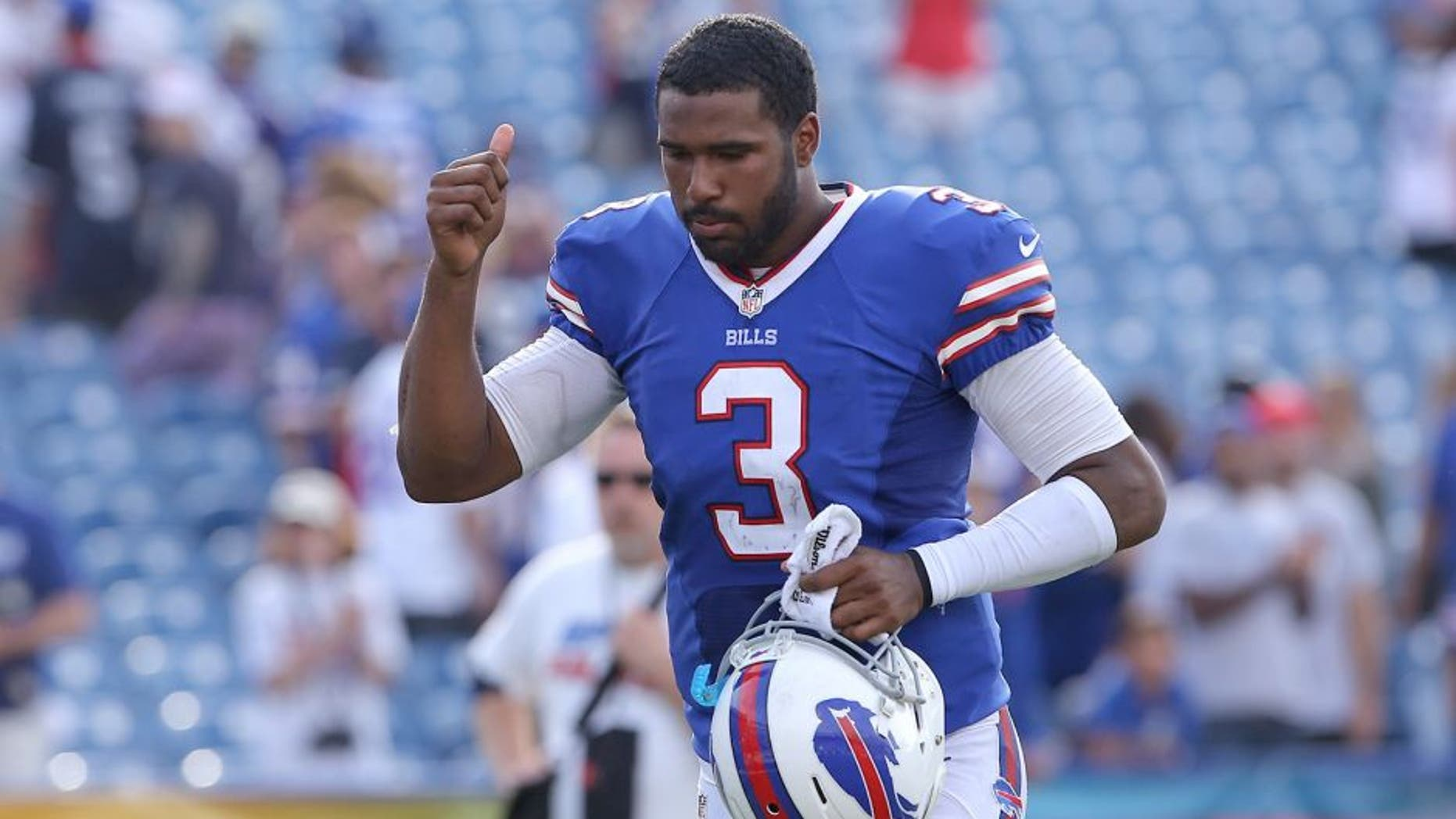 ORCHARD PARK, NY - SEPTEMBER 29: E.J. Manuel #3 of the Buffalo Bills celebrates their victory at the conclusion of their NFL game against the Baltimore Orioles at Ralph Wilson Stadium on September 29, 2013 in Orchard Park, New York. (Photo by Tom Szczerbowski/Getty Images)