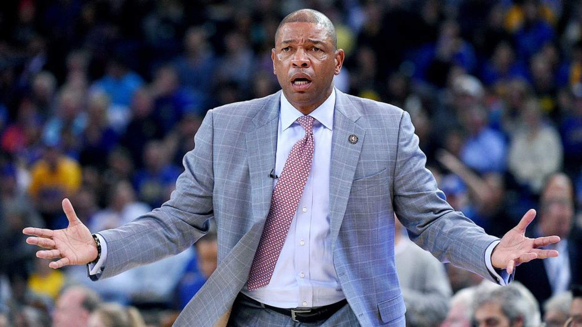 November 5, 2014; Oakland, CA, USA; Los Angeles Clippers head coach Doc Rivers reacts against the Golden State Warriors during the fourth quarter at Oracle Arena. The Warriors defeated the Clippers 121-104. Mandatory Credit: Kyle Terada-USA TODAY Sports