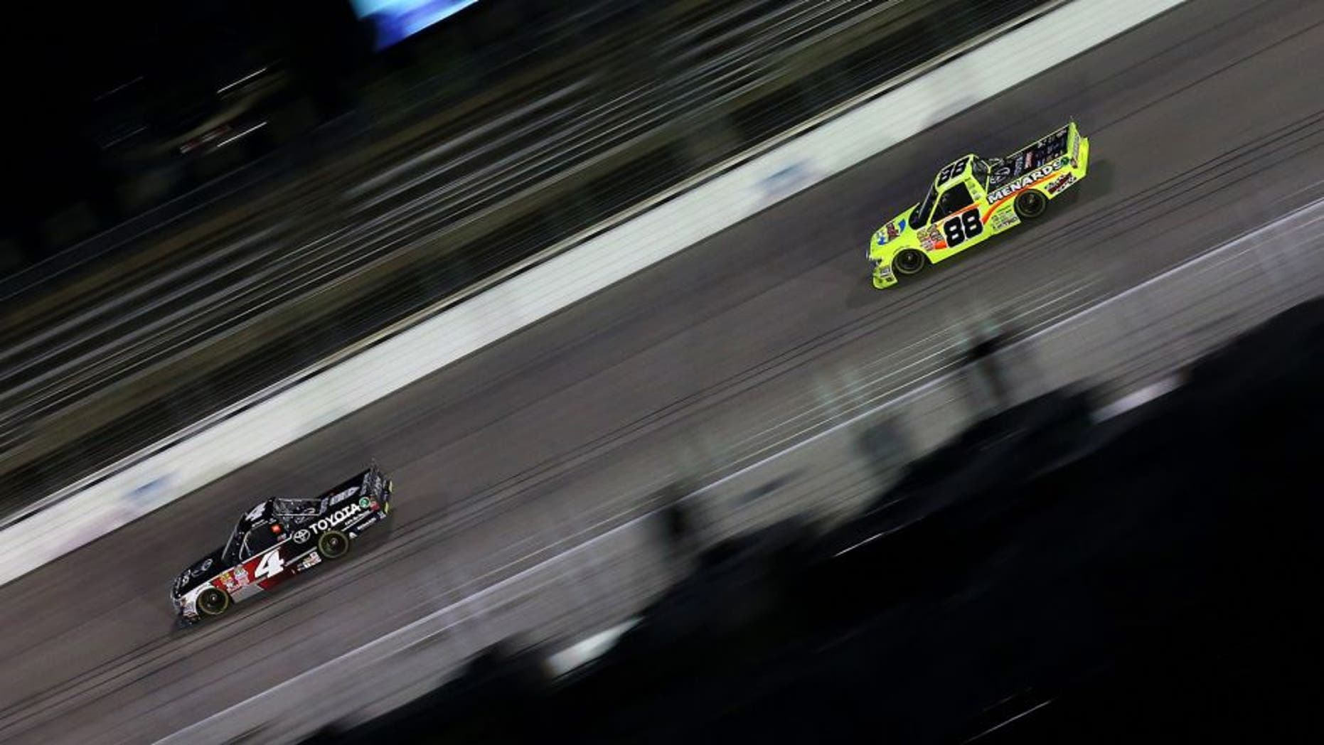 FORT WORTH, TX - NOVEMBER 06: Erik Jones, driver of the #4 Toyota, leads Matt Crafton, driver of the #88 Damp Rid/Menards Toyota, during the NASCAR Camping World Truck Series WinStar World Casino 350 at Texas Motor Speedway on November 6, 2015 in Fort Worth, Texas. (Photo by Sarah Crabill/Getty Images for Texas Motor Speedway)