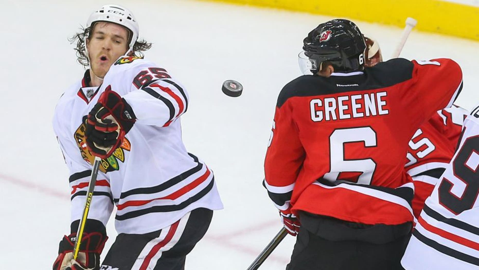 Nov 6, 2015; Newark, NJ, USA; Chicago Blackhawks center Andrew Shaw (65) and New Jersey Devils defenseman Andy Greene (6) look for the puck after a shot during the third period at Prudential Center. The Devils defeated the Blackhawks 4-2. Mandatory Credit: Ed Mulholland-USA TODAY Sports