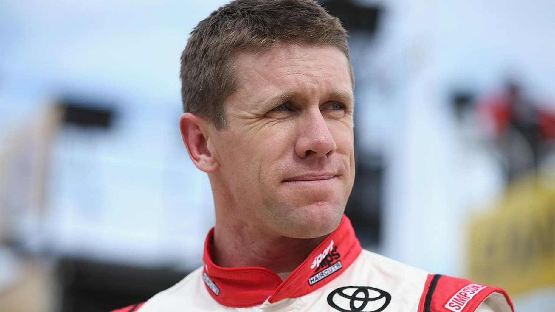 FORT WORTH, TX - NOVEMBER 06: Carl Edwards, driver of the #19 Sport Clips Toyota, stands in the garage area during practice for the NASCAR Sprint Cup Series AAA Texas 500 at Texas Motor Speedway on November 6, 2015 in Fort Worth, Texas. (Photo by Sean Gardner/Getty Images for Texas Motor Speedway)