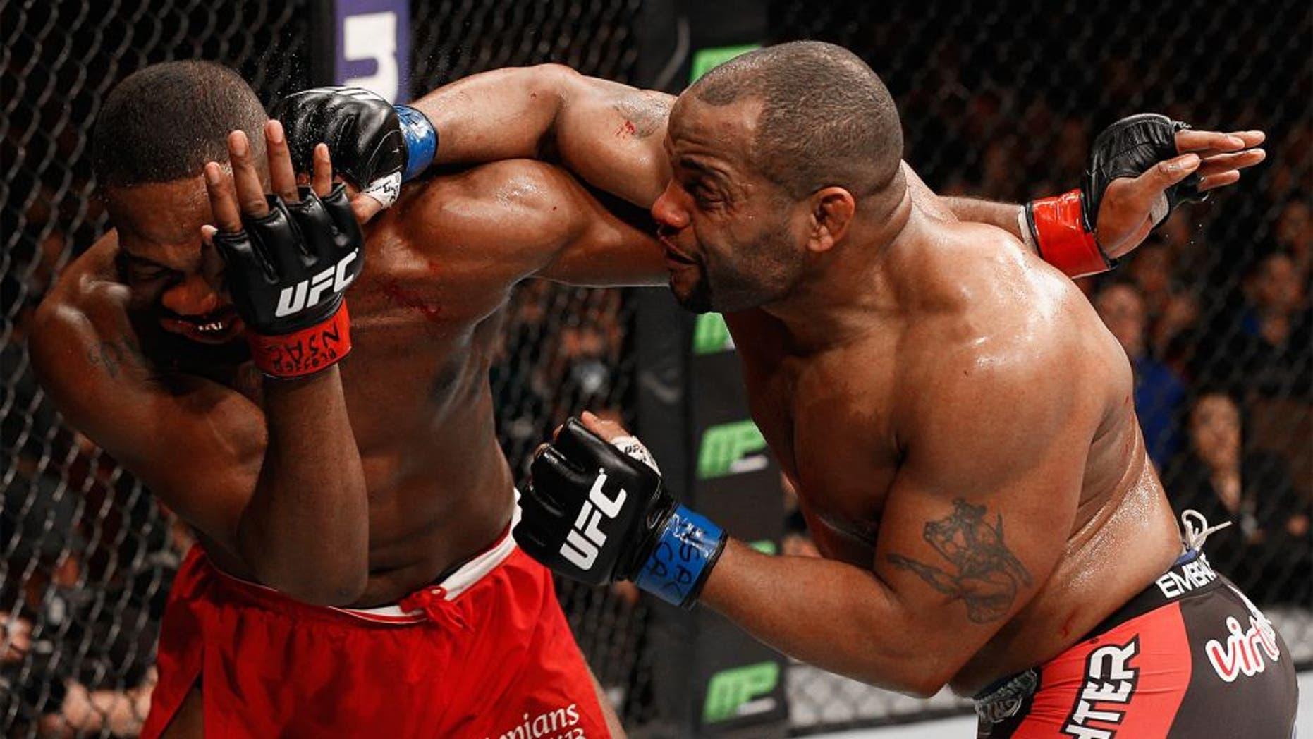 LAS VEGAS, NV - JANUARY 03: Daniel Cormier (R) punches Jon Jones (L) in their UFC light heavyweight championship bout during the UFC 182 event at the MGM Grand Garden Arena on January 3, 2015 in Las Vegas, Nevada. (Photo by Josh Hedges/Zuffa LLC/Zuffa LLC via Getty Images)