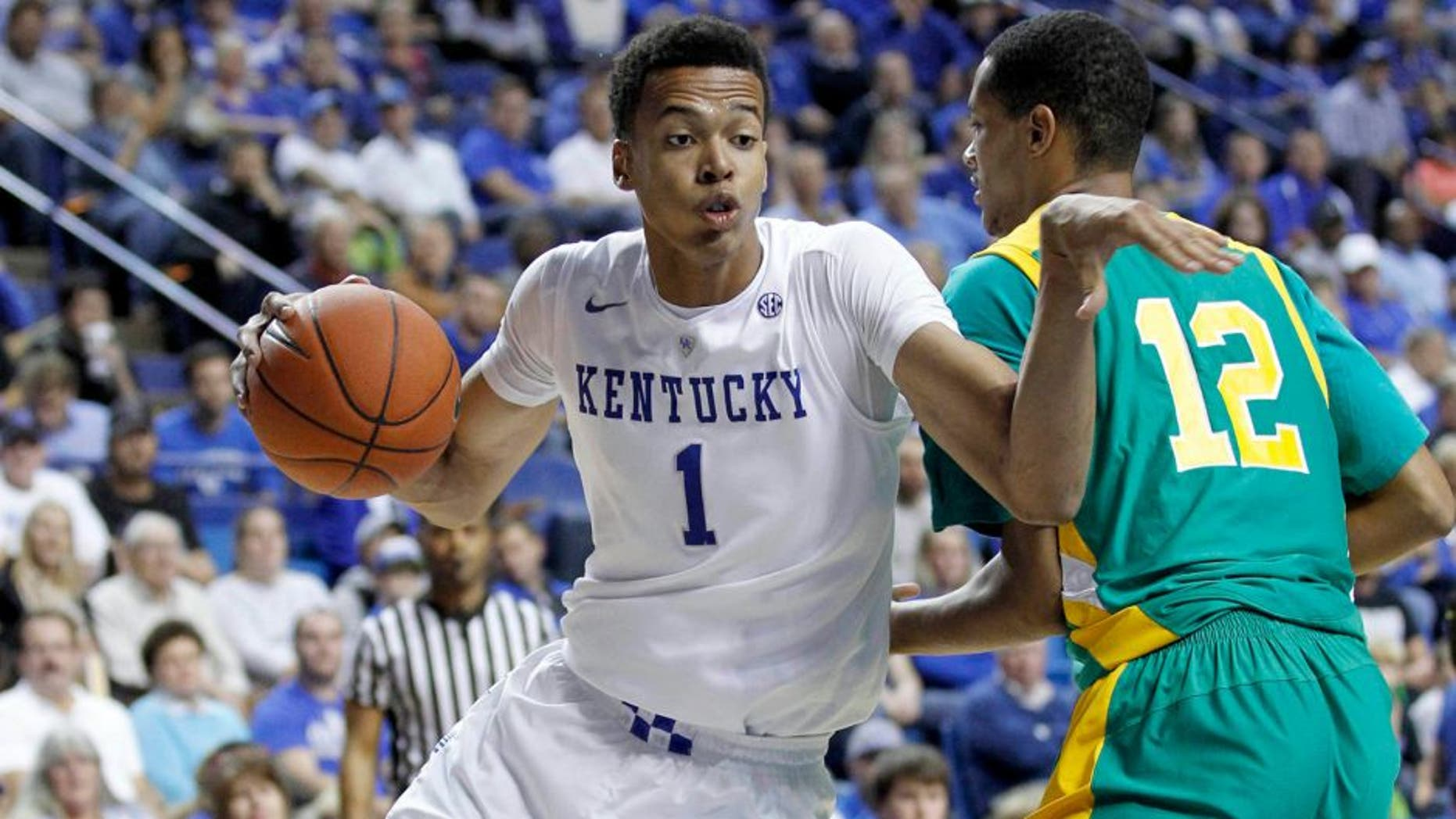 Nov 6, 2015; Lexington, KY, USA; Kentucky Wildcats forward Skal Labissiere (1) dribbles the ball against the Kentucky State Thorobreds center Julius Barton (12) in the second half at Rupp Arena. Kentucky defeated Kentucky State 111-58. Mandatory Credit: Mark Zerof-USA TODAY Sports
