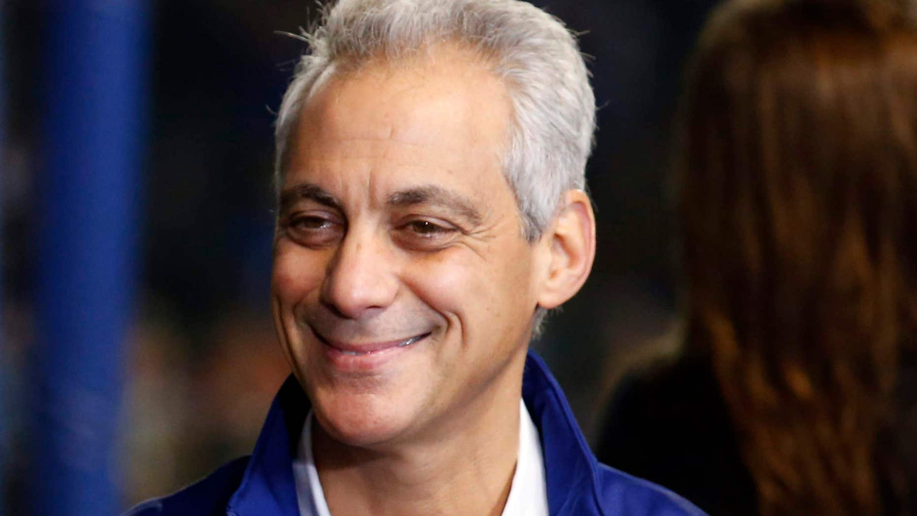 Chicago Mayor Rahm Emanuel speaks during a television interview before Game 4 of the Major League Baseball World Series between the Chicago Cubs and the Cleveland Indians, Saturday, Oct. 29, 2016, in Chicago.