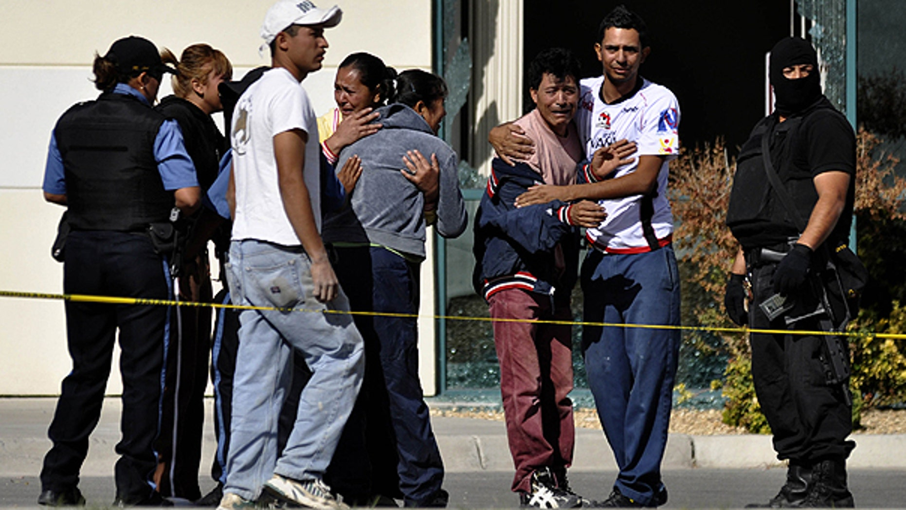Nov. 7: Relatives of fallen police officers react as they arrive to the scene after gunmen attacked a municipal police car in the northern border city of Ciudad Juarez, Mexico.