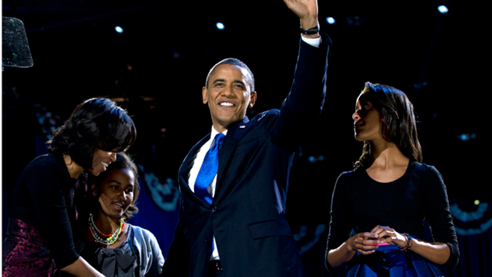 Nov. 7, 2012: President Barack Obama, accompanied by first lady Michelle Obama and daughters Malia and Sasha arrive at the election night party in Chicago.