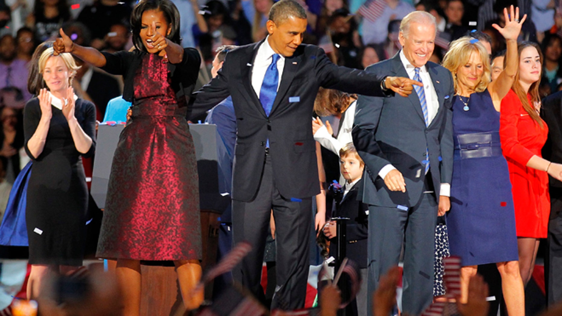 Nov. 7 2012: President Barack Obama , joined by  his wife Michelle, Vice President Joe Biden and his spouse  Jill acknowledge applause  after Obama delivered his victory speech to supporters gathered in Chicago.