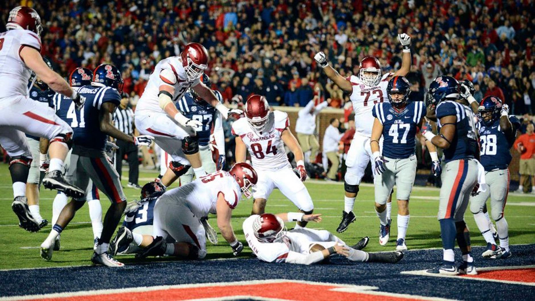 Nov 7, 2015; Oxford, MS, USA; Arkansas Razorbacks players celebrate after quarterback Brandon Allen (10) scored a two point conversion to win in over time in the game at Vaught-Hemingway Stadium. Arkansas won 53-52. Mandatory Credit: Matt Bush-USA TODAY Sports
