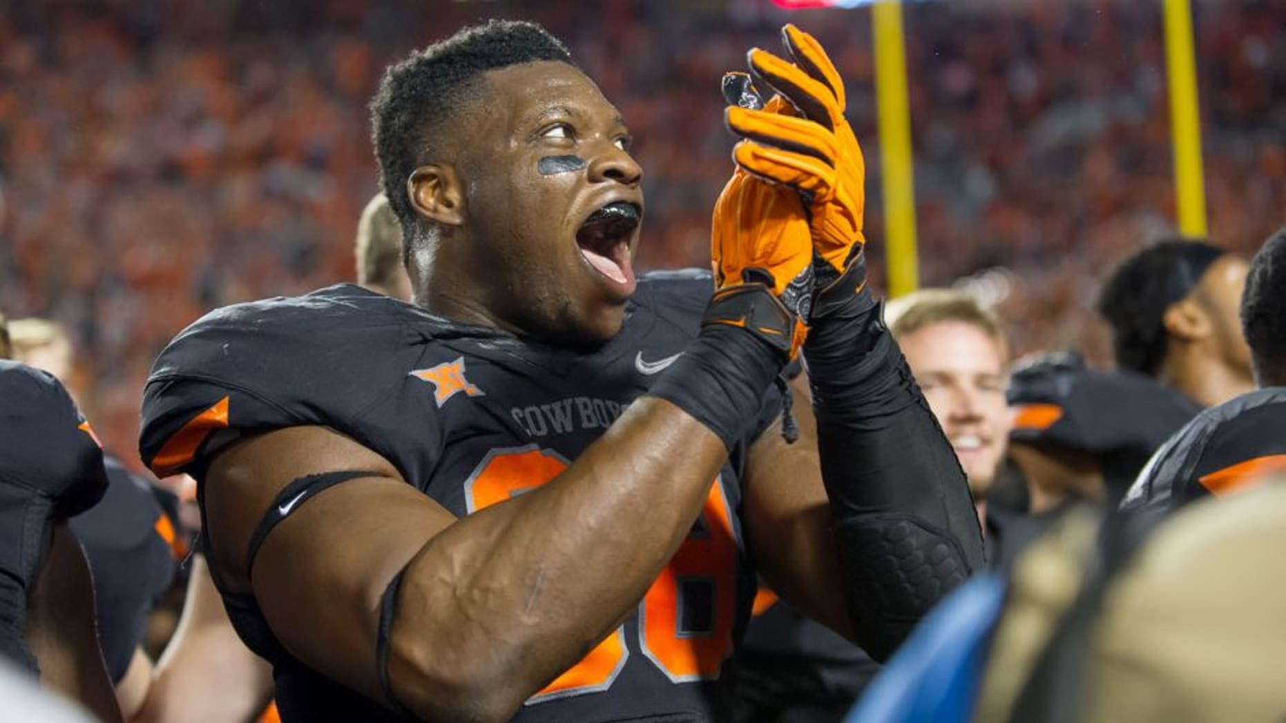 Nov 7, 2015; Stillwater, OK, USA; Oklahoma State Cowboys defensive end Emmanuel Ogbah (38) celebrates after the game against the TCU Horned Frogs at Boone Pickens Stadium. OSU won 49-29. Mandatory Credit: Rob Ferguson-USA TODAY Sports