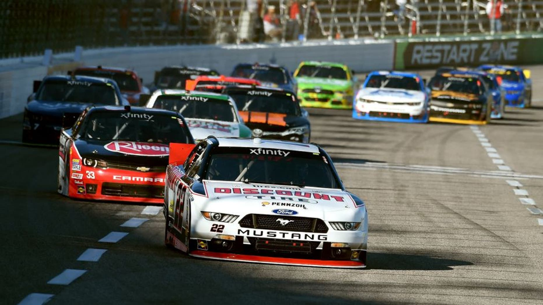 FORT WORTH, TX - NOVEMBER 07: Brad Keselowski, driver of the #22 Discount Tire Ford, leads a pack of cars during the NASCAR XFINITY Series O'Reilly Auto Parts Challenge at Texas Motor Speedway on November 7, 2015 in Fort Worth, Texas. (Photo by Rainier Ehrhardt/NASCAR via Getty Images)