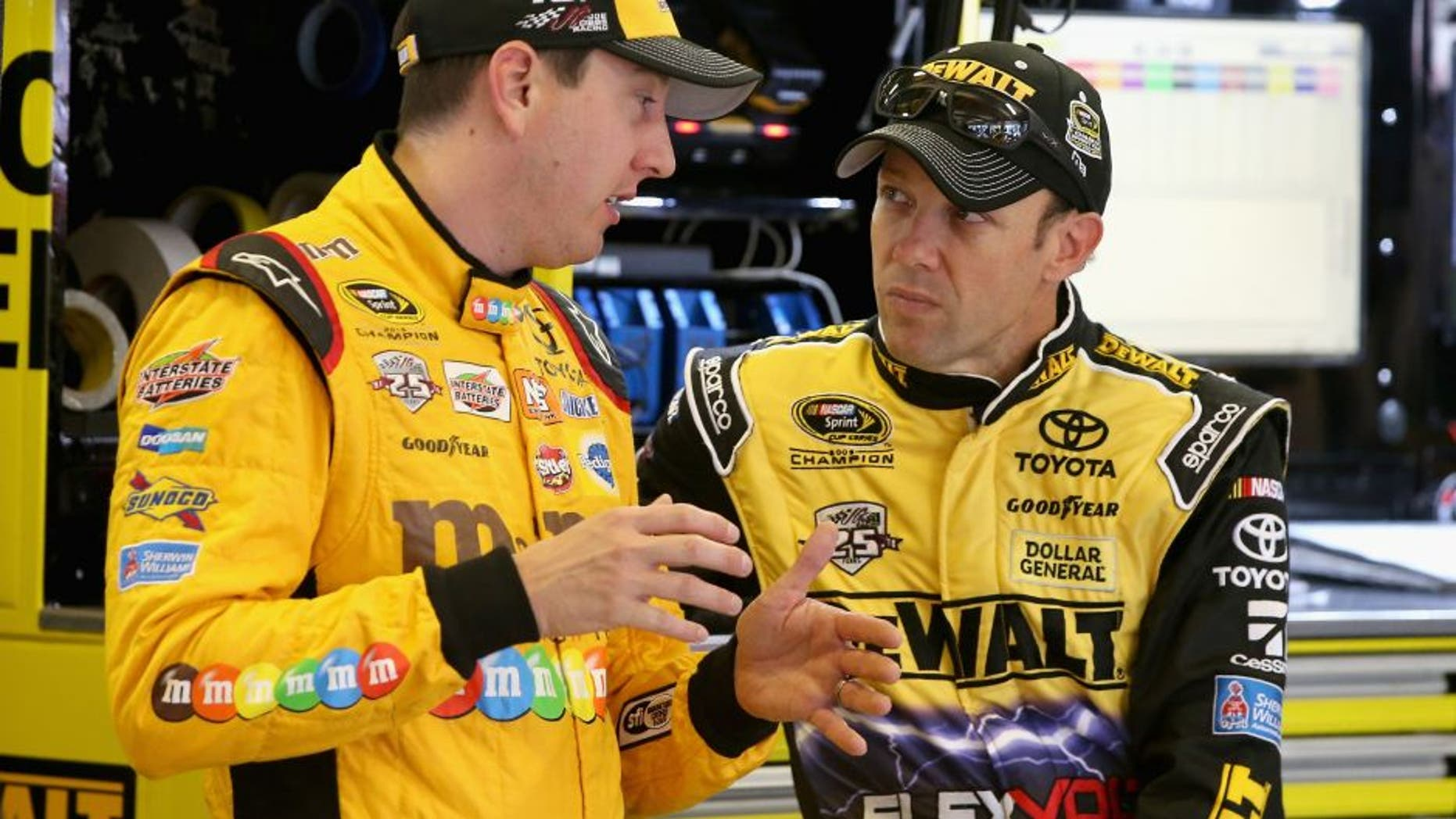 FORT WORTH, TX - NOVEMBER 04: Kyle Busch, driver of the #18 M&M's Toyota, and Matt Kenseth, driver of the #20 DEWALT FLEXVOLT Toyota, talk in the garage area during practice for the NASCAR Sprint Cup Series AAA Texas 500 at Texas Motor Speedway on November 4, 2016 in Fort Worth, Texas. (Photo by Sean Gardner/NASCAR via Getty Images)