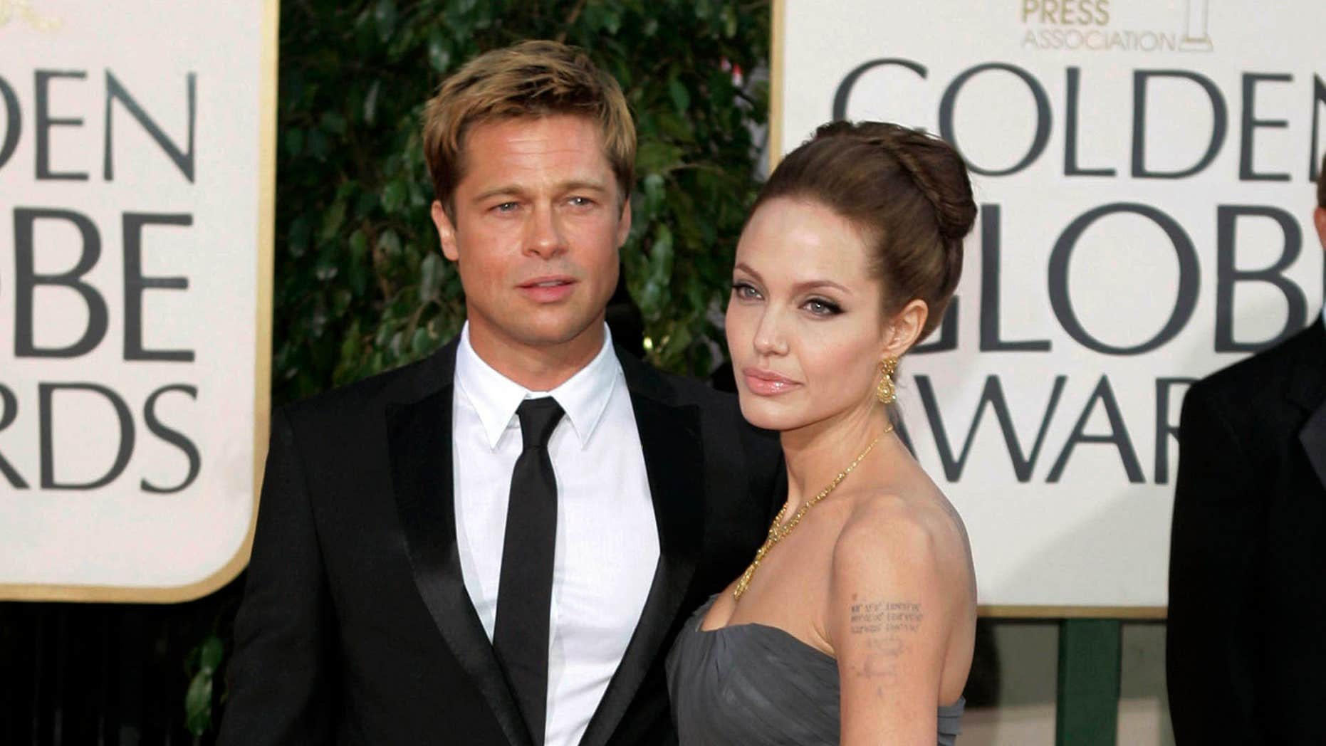 FILE - In this Jan. 15, 2007, file photo, actor Brad Pitt and actress Angelina Jolie arrive for the 64th Annual Golden Globe Awards in Beverly Hills, Calif.