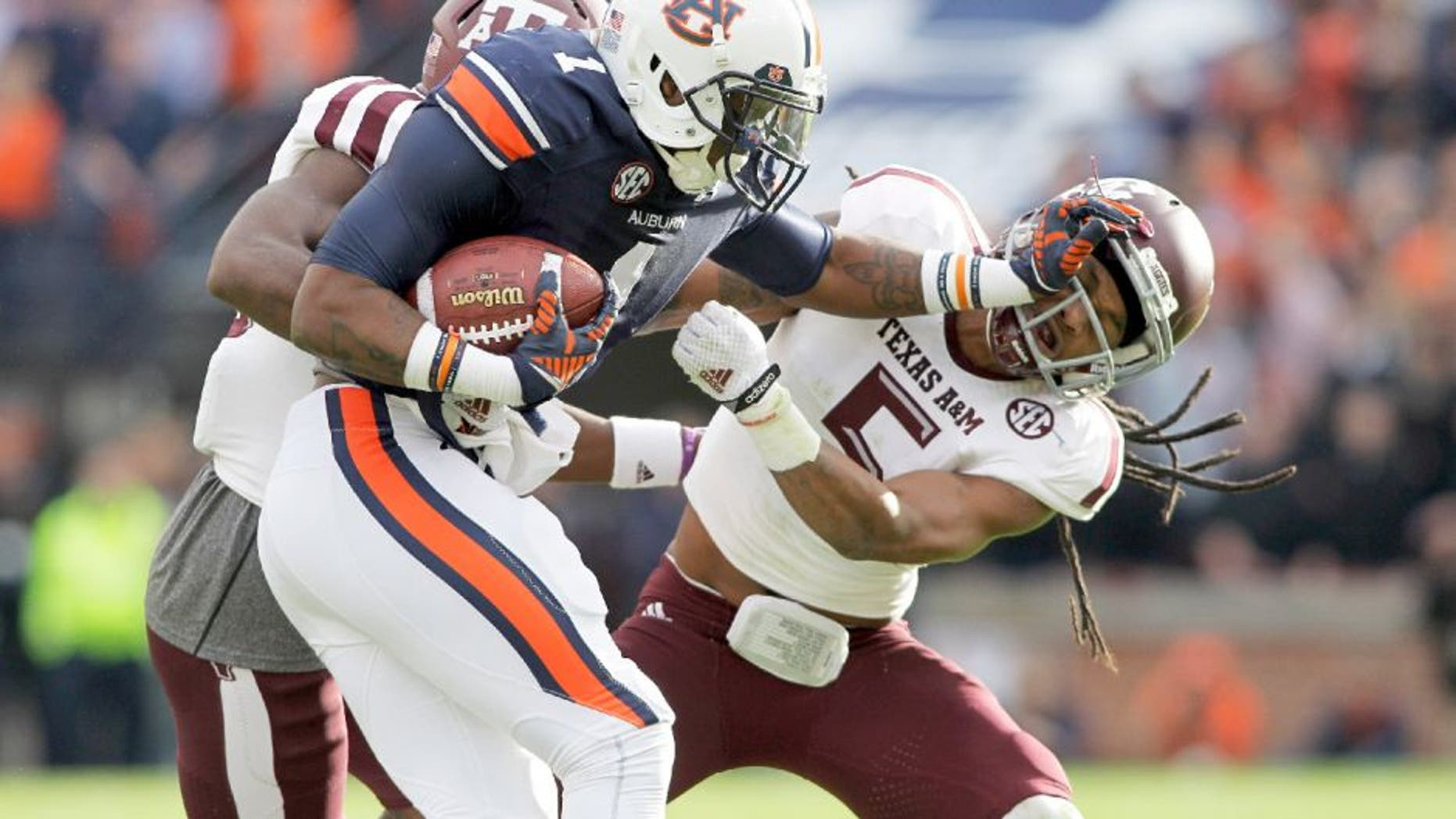 Nov 8, 2014; Auburn, AL, USA; Auburn Tigers receiver receiver D'haquille Williams (1) blocks Texas A&M Aggies defensive back Floyd Raven, Sr. (5) during the first half at Jordan Hare Stadium. Mandatory Credit: John Reed-USA TODAY Sports