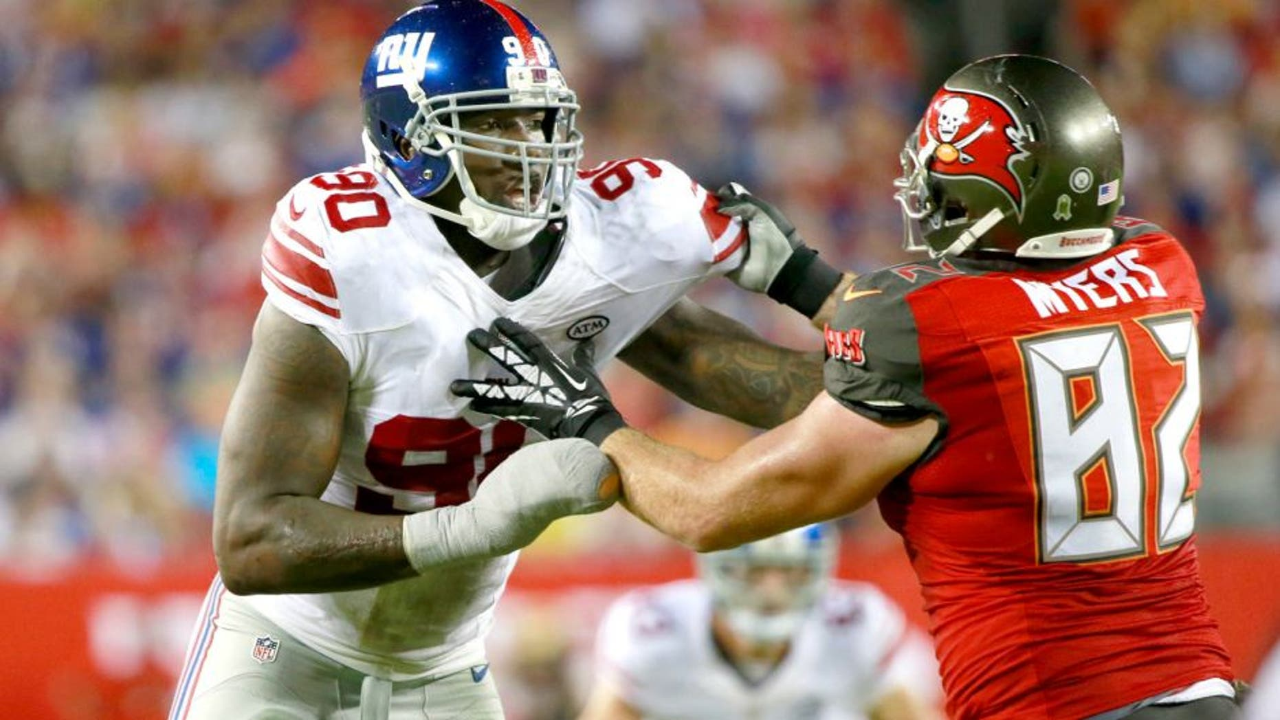 Nov 8, 2015; Tampa, FL, USA; New York Giants defensive end Jason Pierre-Paul (90) rushes as Tampa Bay Buccaneers tight end Brandon Myers (82) blocks during the second half at Raymond James Stadium. New York Giants defeated the Tampa Bay Buccaneers 32-18. Mandatory Credit: Kim Klement-USA TODAY Sports