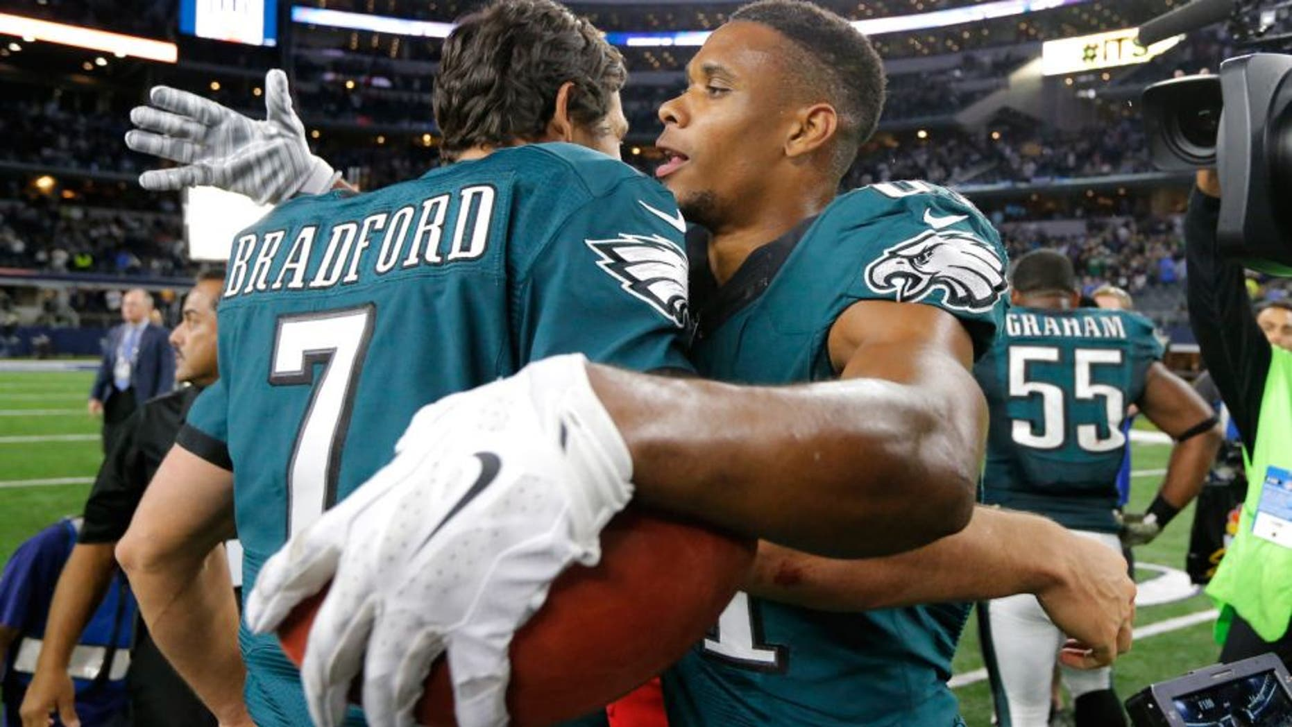 Philadelphia Eagles' Sam Bradford (7) and Jordan Matthews (81) celebrate a touchdown catch made by Matthews in overtime of an NFL football game against the Dallas Cowboys on Sunday, Nov. 8, 2015, in Arlington, Texas. The Eagles won 33-27. (AP Photo/Brandon Wade)