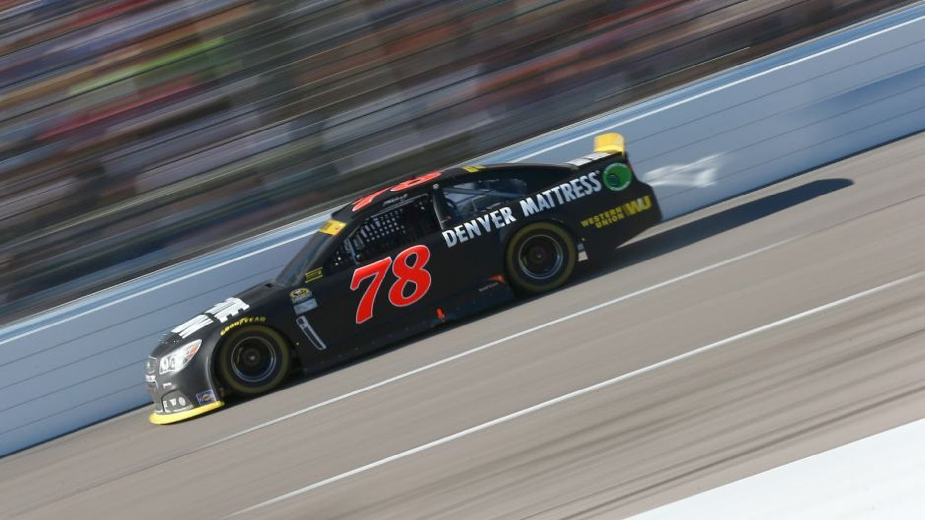 FORT WORTH, TX - NOVEMBER 08: Martin Truex Jr., driver of the #78 Furniture Row/Visser Precision Chevrolet, races during the NASCAR Sprint Cup Series AAA Texas 500 at Texas Motor Speedway on November 8, 2015 in Fort Worth, Texas. (Photo by Sarah Crabill/Getty Images for Texas Motor Speedway)