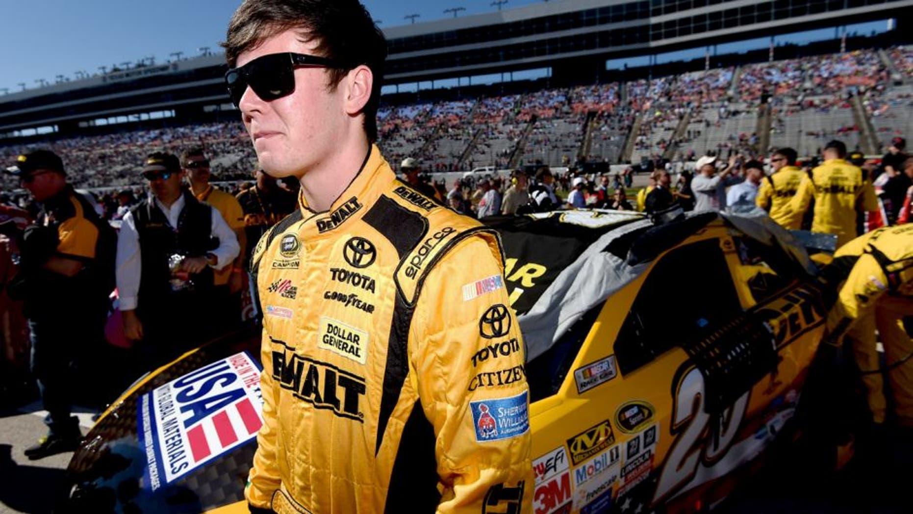 FORT WORTH, TX - NOVEMBER 08: Erik Jones, driver of the #20 DeWalt Toyota, stands on the grid during the NASCAR Sprint Cup Series AAA Texas 500 at Texas Motor Speedway on November 8, 2015 in Fort Worth, Texas. (Photo by Rainier Ehrhardt/NASCAR via Getty Images)