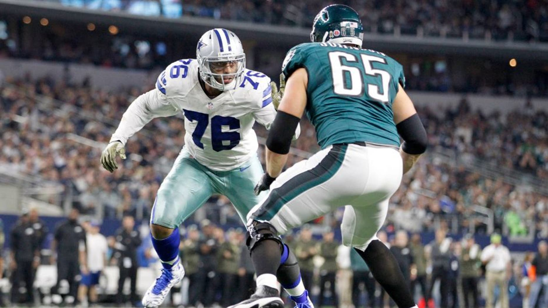 Nov 8, 2015; Arlington, TX, USA; Dallas Cowboys defensive end Greg Hardy (76) rushes the passer against Philadelphia Eagles tackle Lane Johnson (65) in the third quarterat AT&T Stadium. Mandatory Credit: Tim Heitman-USA TODAY Sports