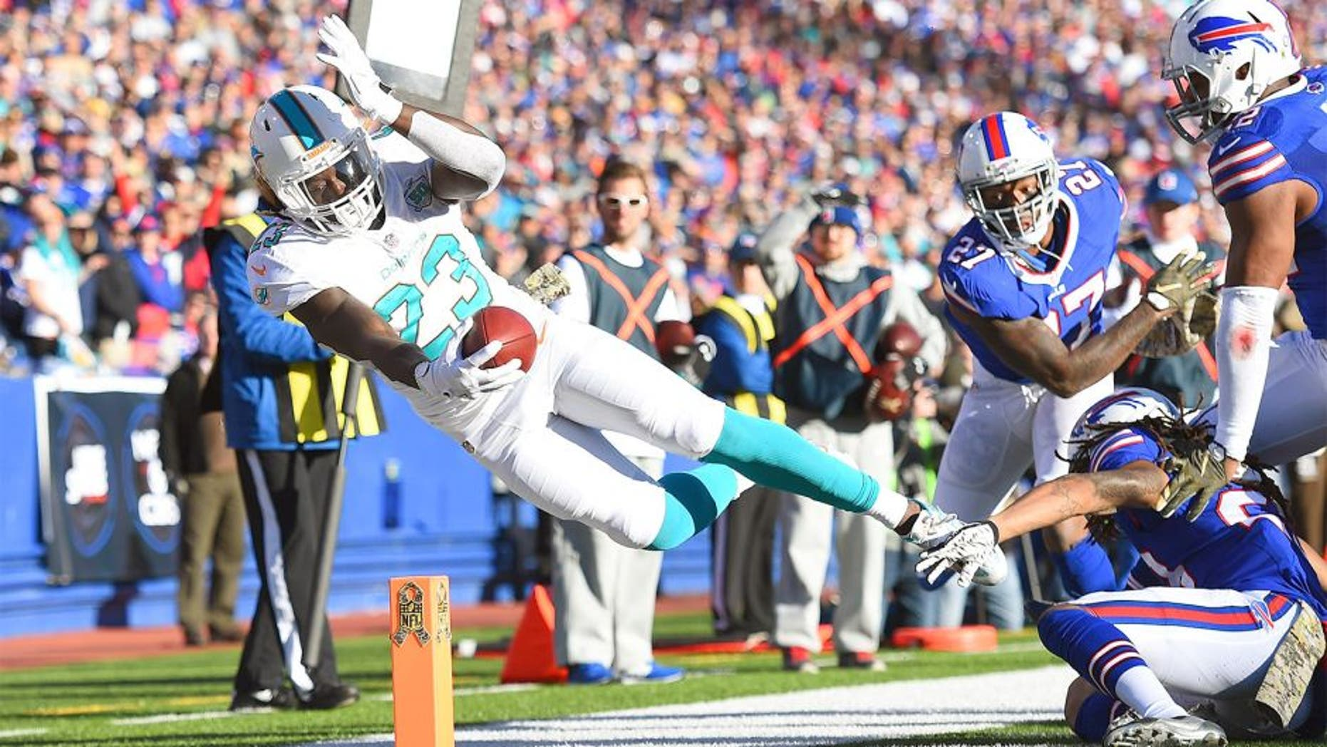 ORCHARD PARK, NY - NOVEMBER 08: Jay Ajayi #23 of the Miami Dolphins comes up short of a touchdown against the Buffalo Bills during the second half at Ralph Wilson Stadium on November 8, 2015 in Orchard Park, New York. (Photo by Rich Barnes/Getty Images)