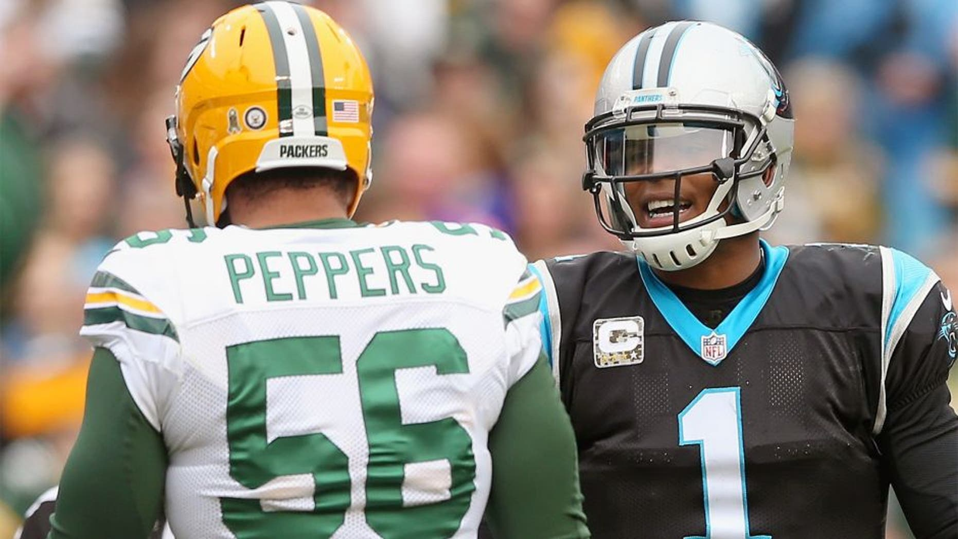 CHARLOTTE, NC - NOVEMBER 08: Cam Newton #1 of the Carolina Panthers talks to Julius Peppers #56 of the Green Bay Packers in the 1st half during their game at Bank of America Stadium on November 8, 2015 in Charlotte, North Carolina. (Photo by Streeter Lecka/Getty Images)
