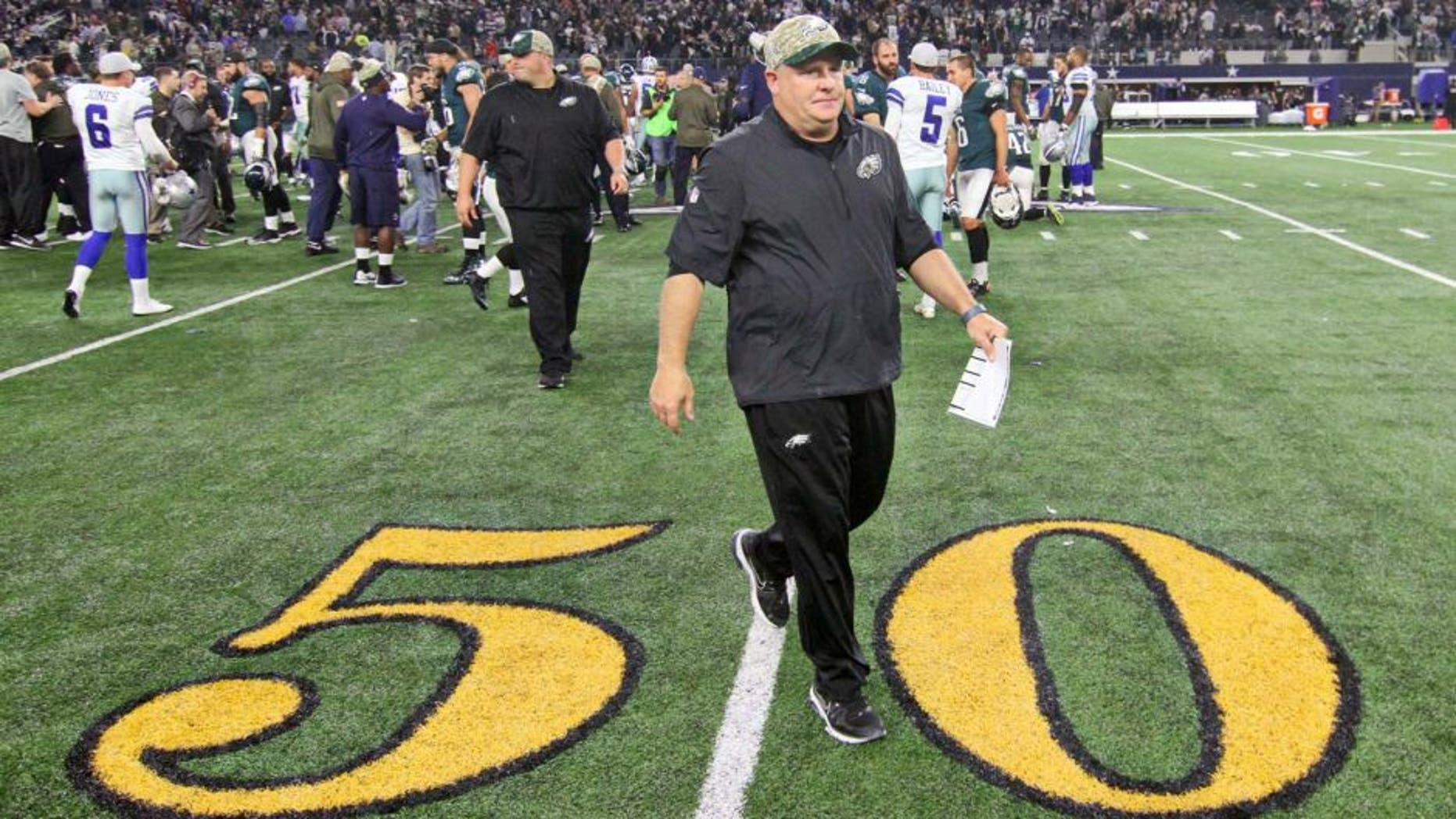 Nov 8, 2015; Arlington, TX, USA; Philadelphia Eagles head coach Chip Kelly leaves the field following a game against the Dallas Cowboys at AT&T Stadium. Eagles won 33-27 in overtime. Mandatory Credit: Ray Carlin-USA TODAY Sports