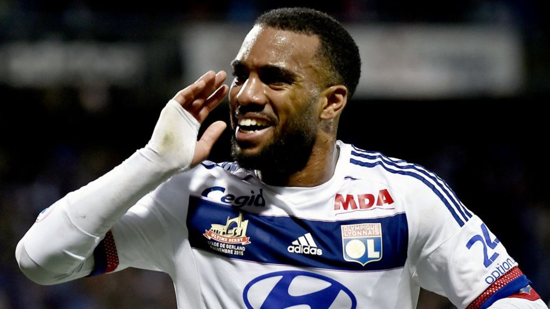 Lyon's French forward Alexandre Lacazette celebrates after scoring a goal during the French L1 football match between Lyon and Saint-Etienne at the Gerland stadium in Lyon, southeastern France, on November 8, 2015. AFP PHOTO / JEFF PACHOUD (Photo credit should read JEFF PACHOUD/AFP/Getty Images)