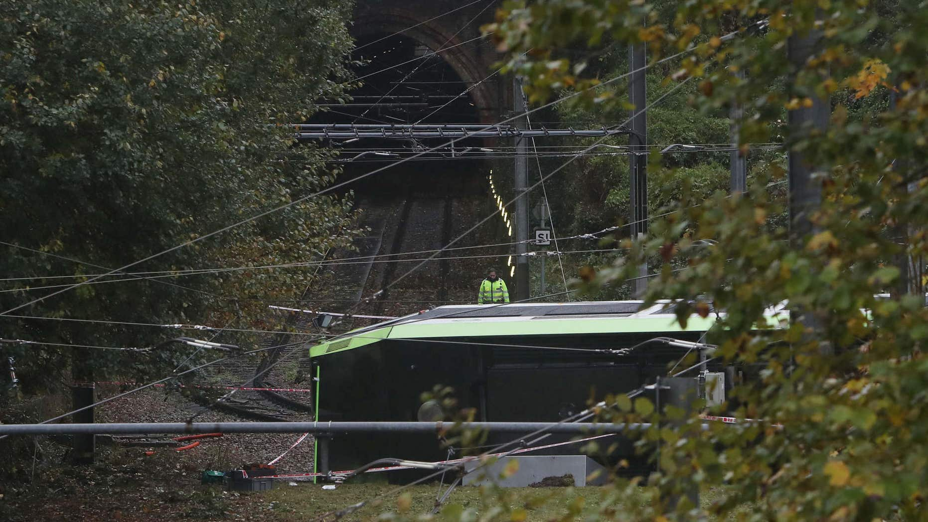 Nov. 9, 2016: An emergency services worker looks at a derailed tram in Croydon, south London.