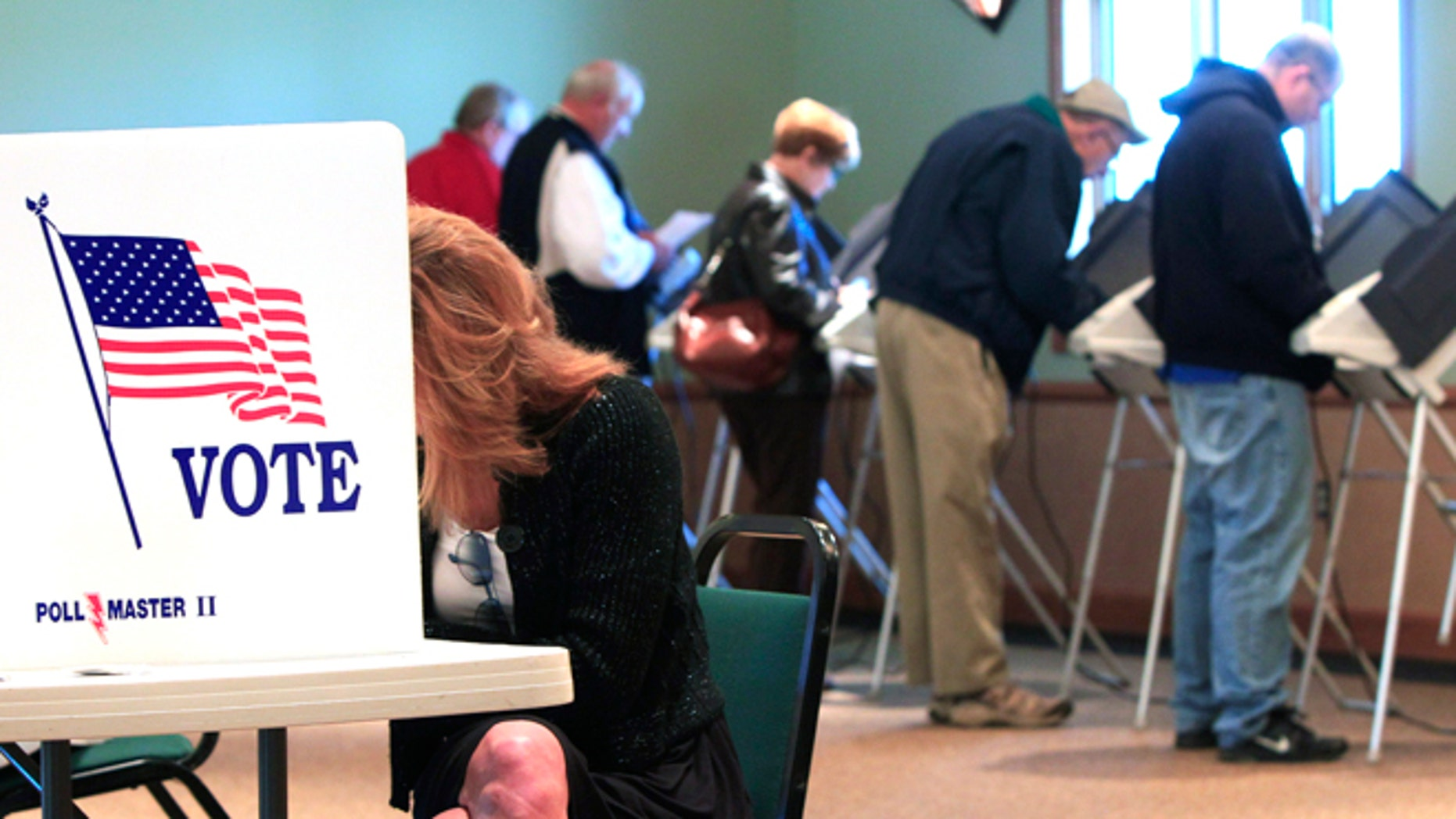 Nov. 6, 2012: A steady stream of voters fill the voting booths at Ronald Reagan Lodge in West Chester, Ohio.