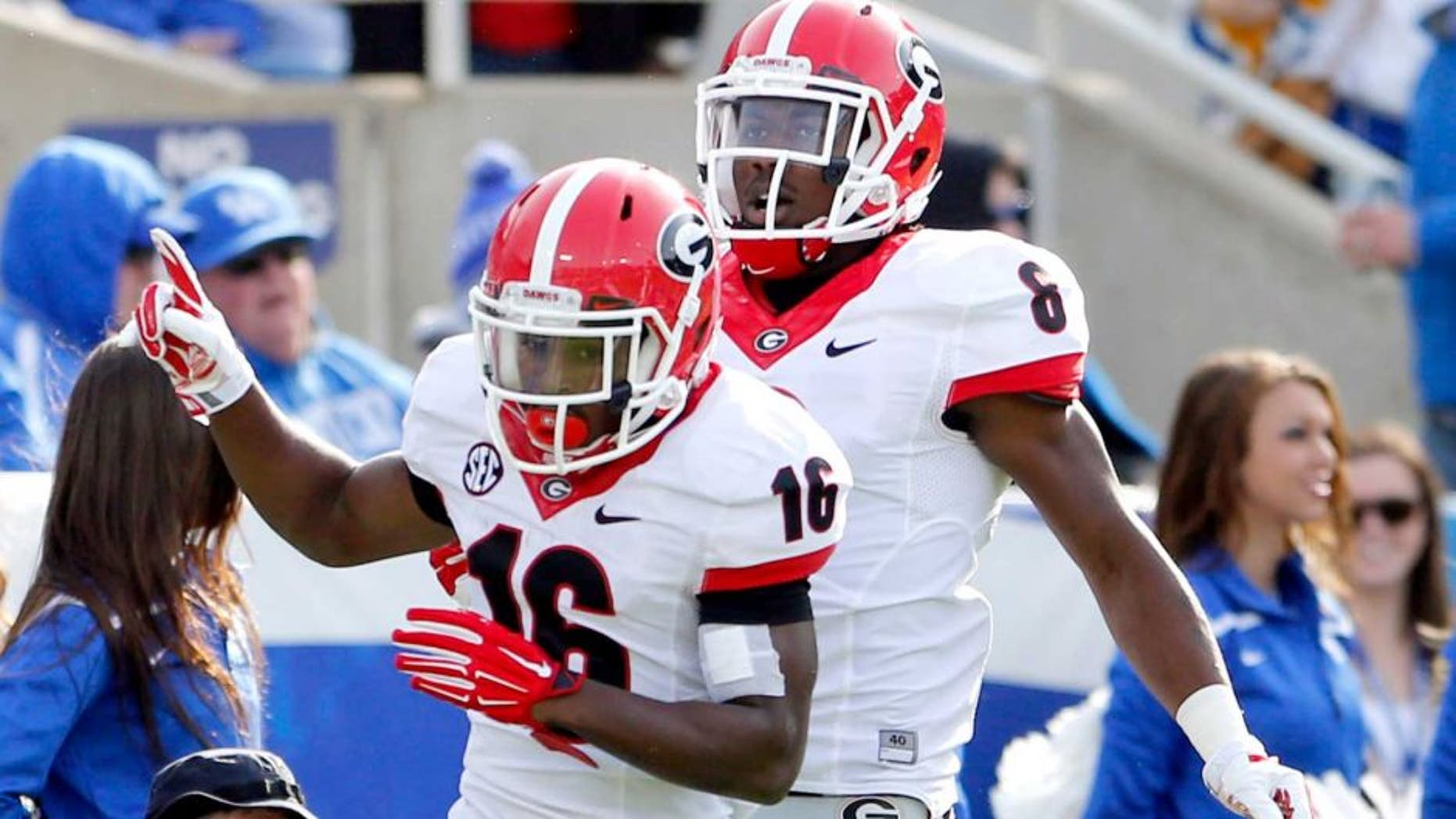 Nov 8, 2014; Lexington, KY, USA; Georgia Bulldogs wide receiver Isaiah McKenzie (16) and flanker Blake Tibbs (8) celebrate during the game against the Kentucky Wildcats at Commonwealth Stadium. Georgia defeated Kentucky 63-31. Mandatory Credit: Mark Zerof-USA TODAY Sports