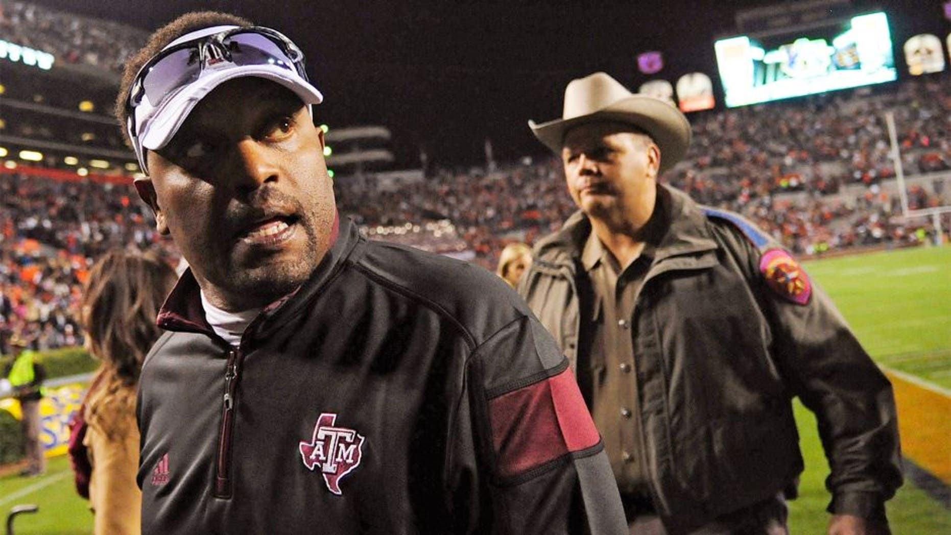 Nov 8, 2014; Auburn, AL, USA; Texas A&M Aggies head coach Kevin Sumlin leaves the field after the game against the Auburn Tigers at Jordan Hare Stadium. Texas A&M won 41-38. Mandatory Credit: Shanna Lockwood-USA TODAY Sports