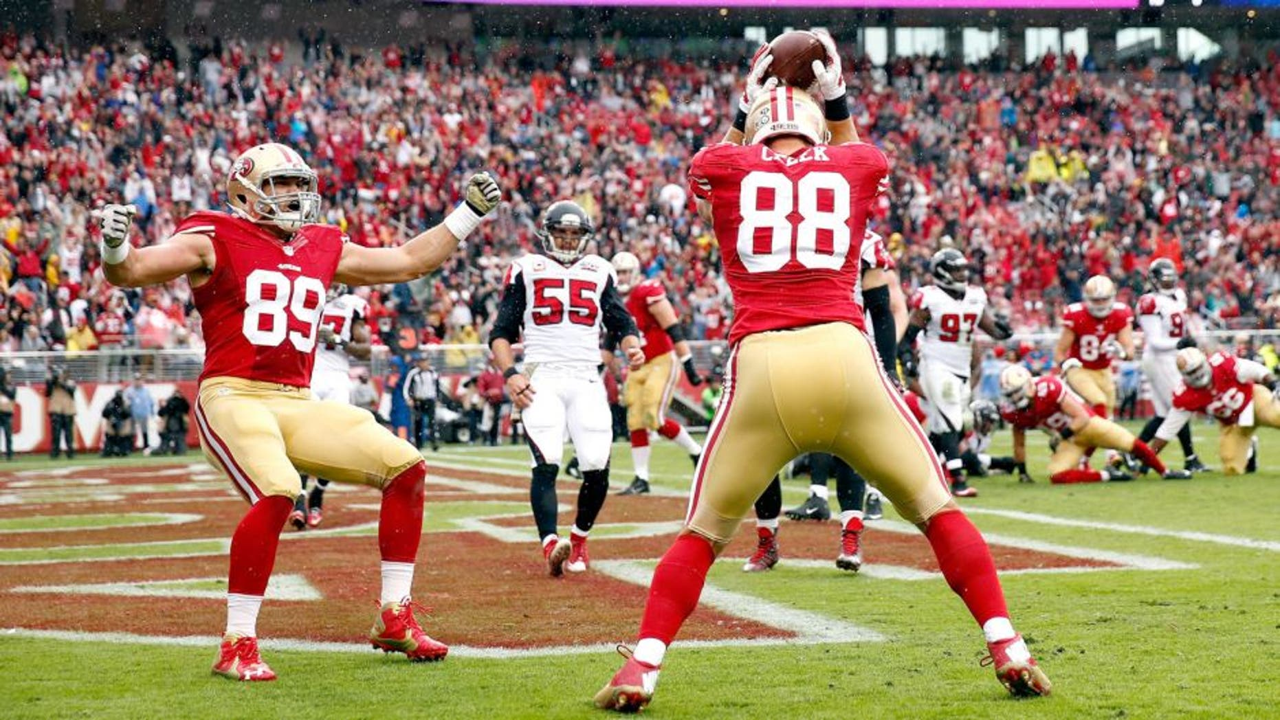 SANTA CLARA, CA - NOVEMBER 08: Vance McDonald #89 celebrates with Garrett Celek #88 of the San Francisco 49ers after Celek made a touchdown against the Atlanta Falcons at Levi's Stadium on November 8, 2015 in Santa Clara, California. (Photo by Ezra Shaw/Getty Images)