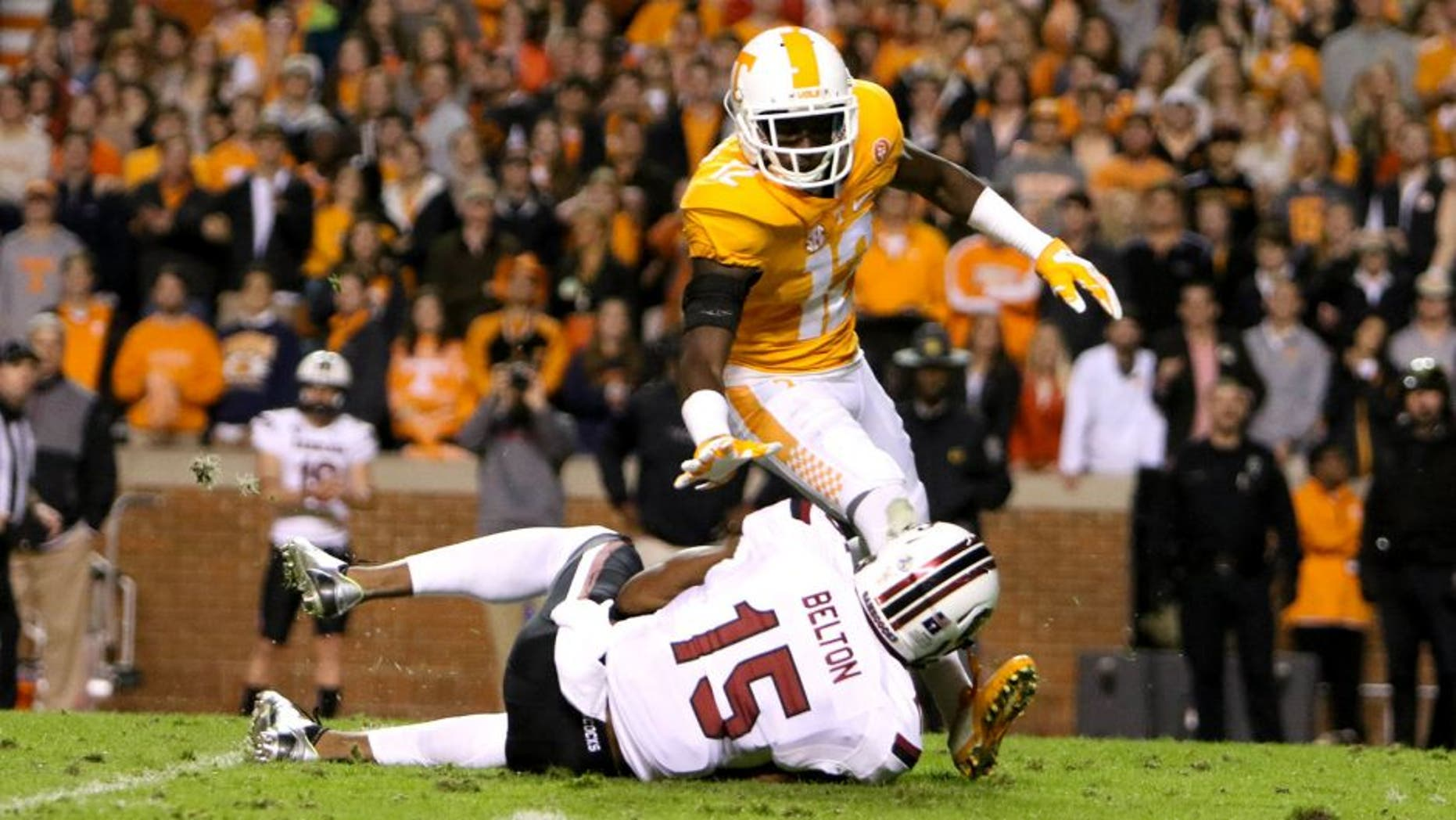 Nov 7, 2015; Knoxville, TN, USA; South Carolina Gamecocks wide receiver Matrick Belton (15) with the ball while defended by Tennessee Volunteers defender Emmanuel Moseley at Neyland Stadium. Mandatory Credit: Randy Sartin-USA TODAY Sports.