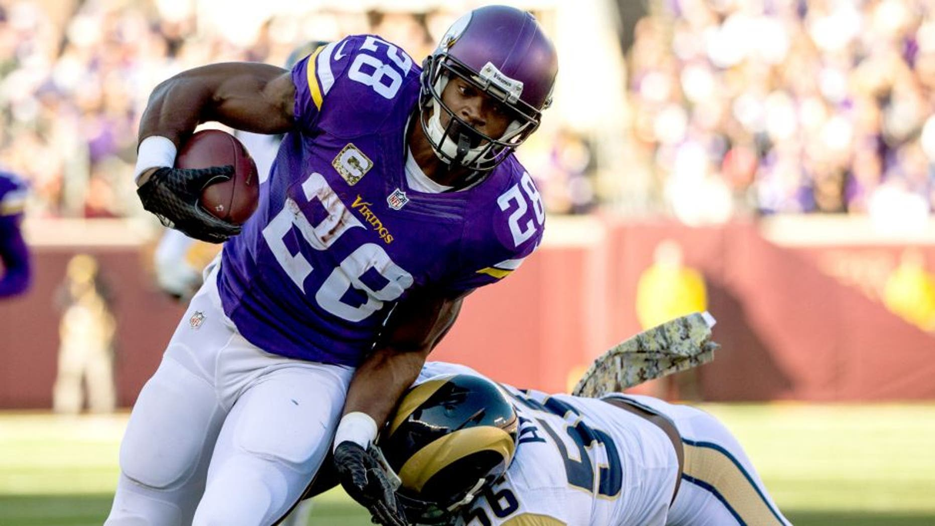 Nov 8, 2015; Minneapolis, MN, USA; Minnesota Vikings running back Adrian Peterson (28) carries the ball during the first quarter against the St. Louis Rams at TCF Bank Stadium. Mandatory Credit: Brace Hemmelgarn-USA TODAY Sports