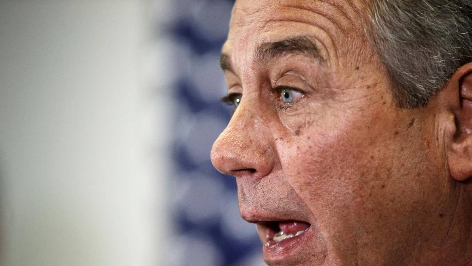"House Speaker John Boehner of Ohio says Senate Democrats should ""get off their ass"" and pass a bill to fund the Homeland Security Department and restrict President Barack Obama's executive moves on immigration, Wednesday, Feb. 11, 2015, during a news conference following a GOP strategy meeting, on Capitol Hill in Washington. His comments Wednesday underscored a worsening stalemate on Capitol Hill with funding for the Homeland Security Department set to expire Feb. 27. A day earlier, Senate Majority Leader Mitch McConnell declared the Senate ""stuck"" on the issue and said the next move was in the House's court. (AP Photo/J. Scott Applewhite)"