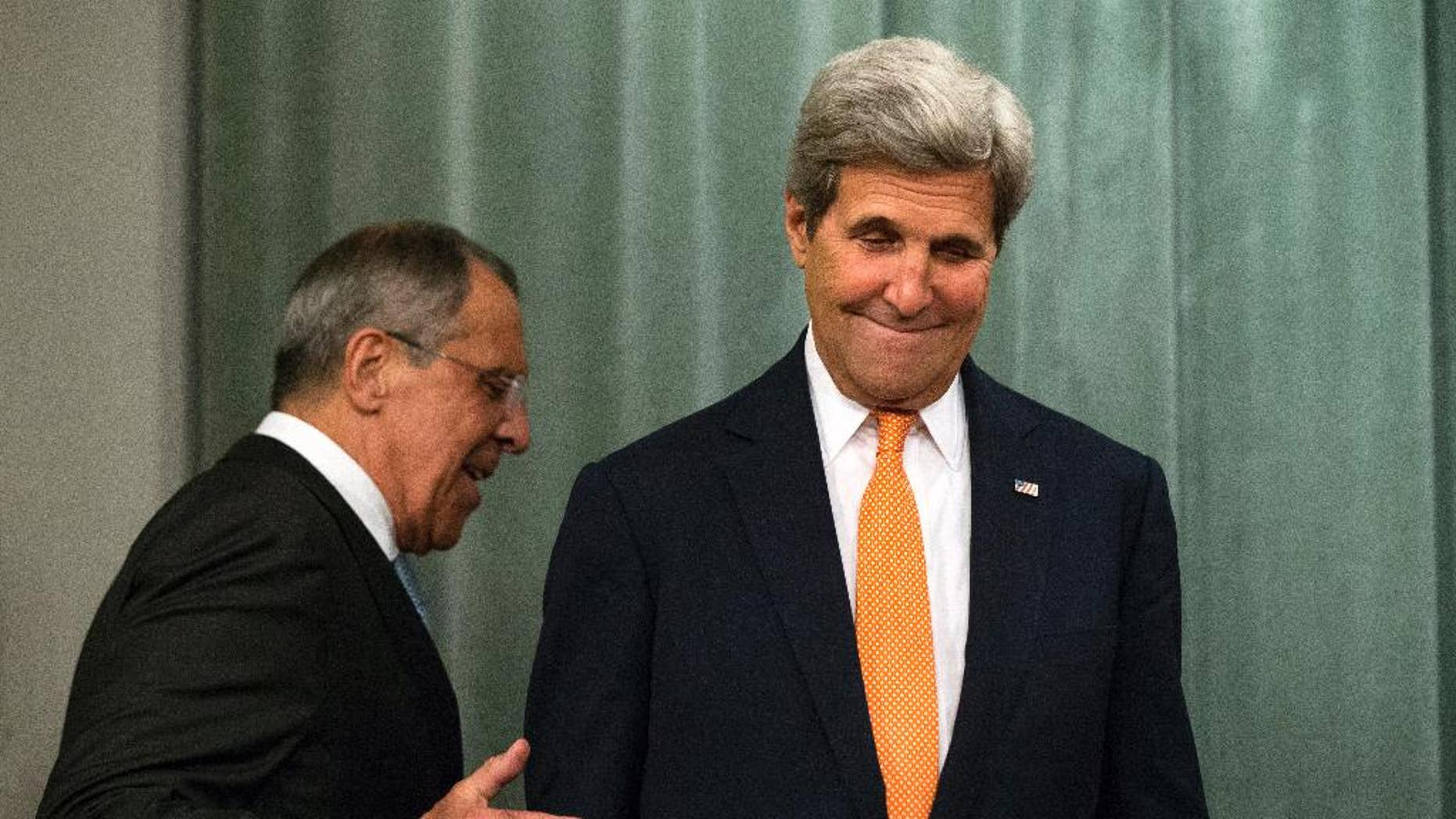 U.S. Secretary of State John Kerry, right, and Russian Foreign Minister Sergey Lavrov arrive to a news conference after their long talks in Moscow, Russia, Friday, July 15, 2016. The United States is offering Russia a broad new military partnership in Syria. (AP Photo/Alexander Zemlianichenko)