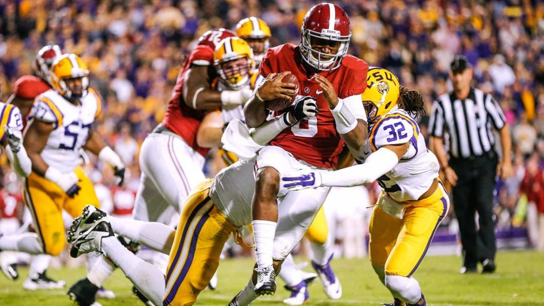 Nov 8, 2014; Baton Rouge, LA, USA; Alabama Crimson Tide quarterback Blake Sims (6) is tackled by LSU Tigers defensive end Jermauria Rasco (59) during the fourth quarter of a game at Tiger Stadium. Alabama defeated LSU 20-13. Mandatory Credit: Derick E. Hingle-USA TODAY Sports