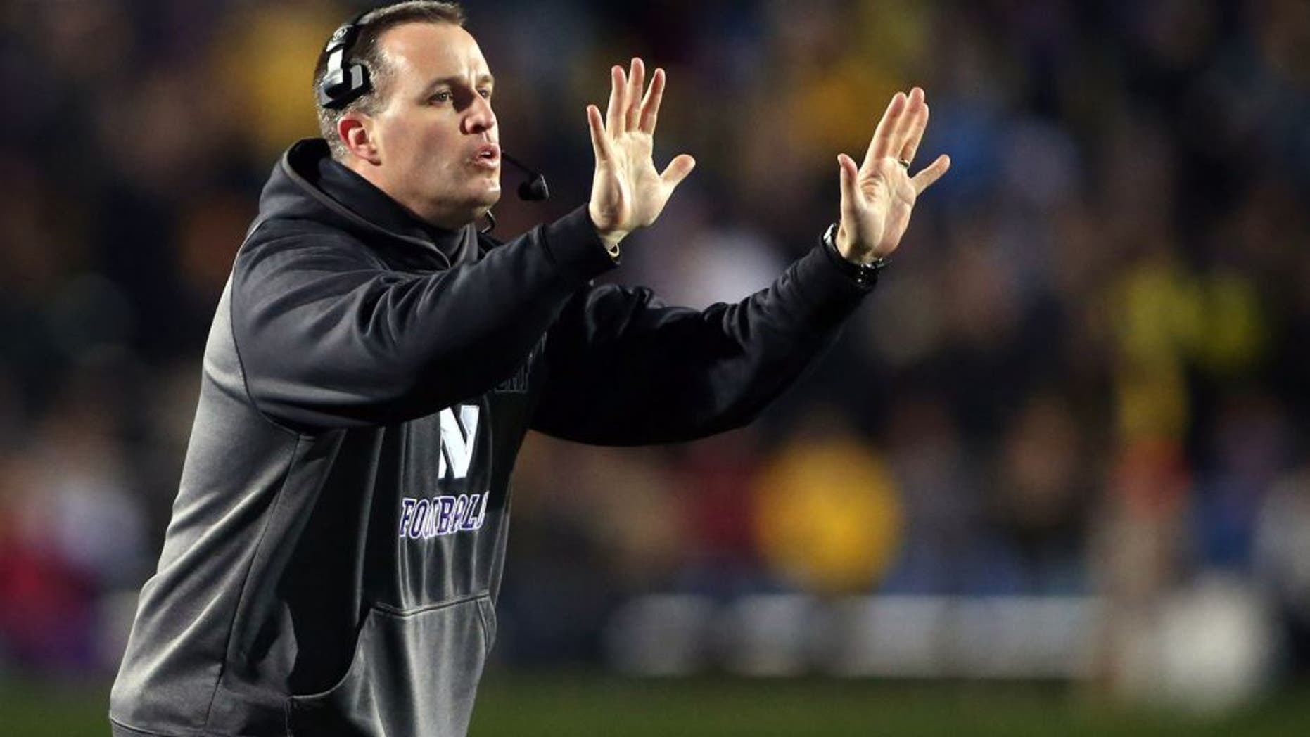 Nov 8, 2014; Evanston, IL, USA; Northwestern Wildcats head coach Pat Fitzgerald gestures to his team in the fourth quarter against the Michigan Wolverines at Ryan Field. Mandatory Credit: Jerry Lai-USA TODAY Sports